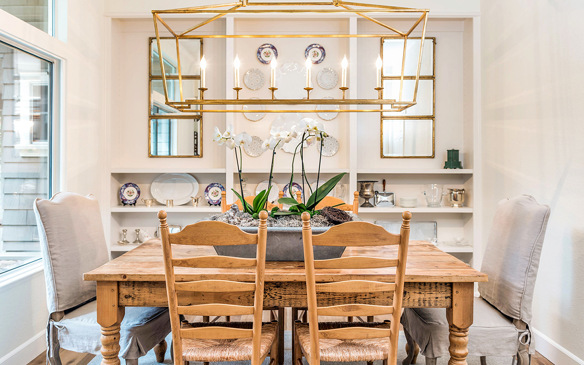 An assortment of new and vintage plates add color and reflection to this dining room.