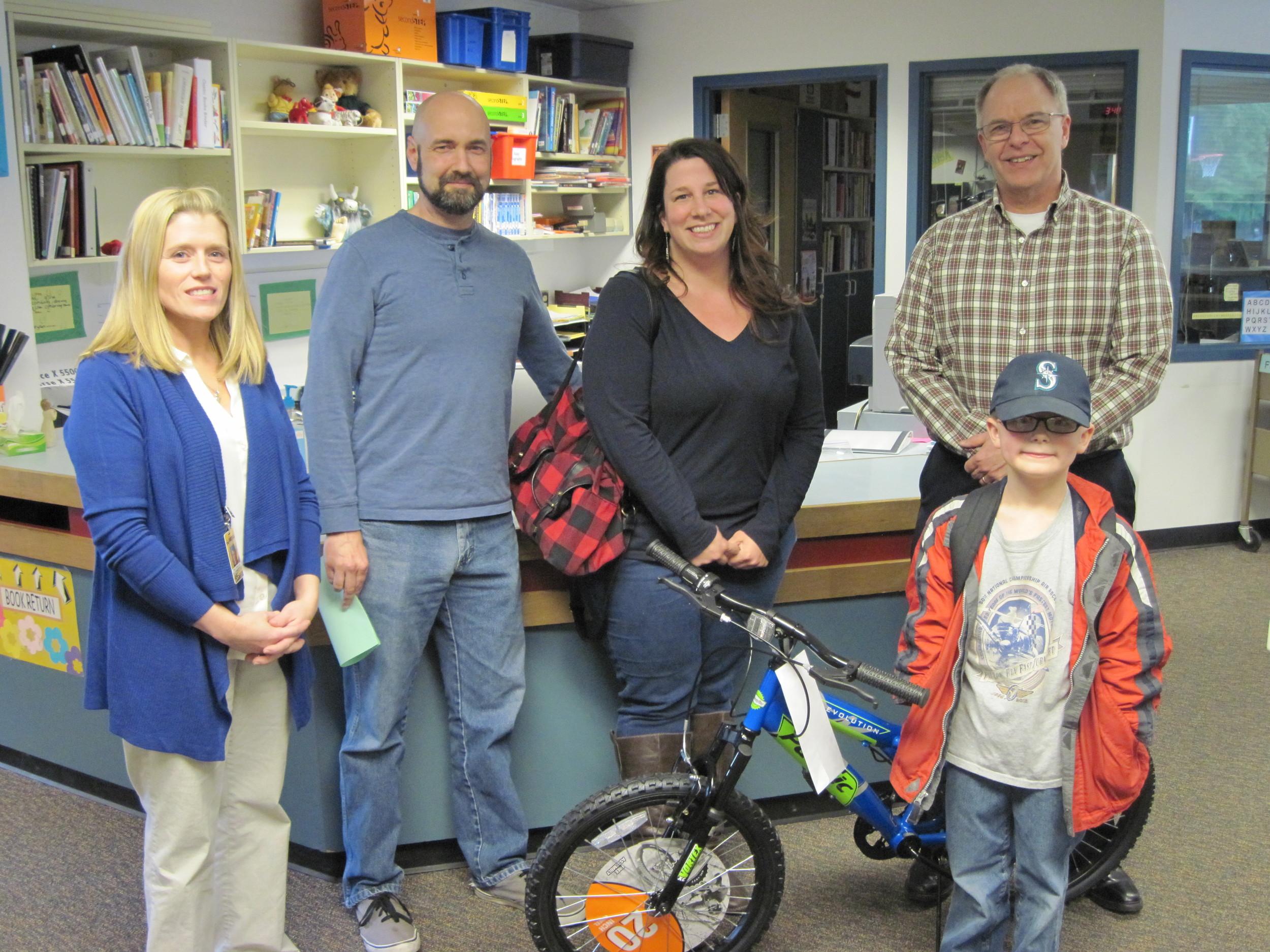A Happy Reader Wins a Bike at West Hill El 2015.JPG