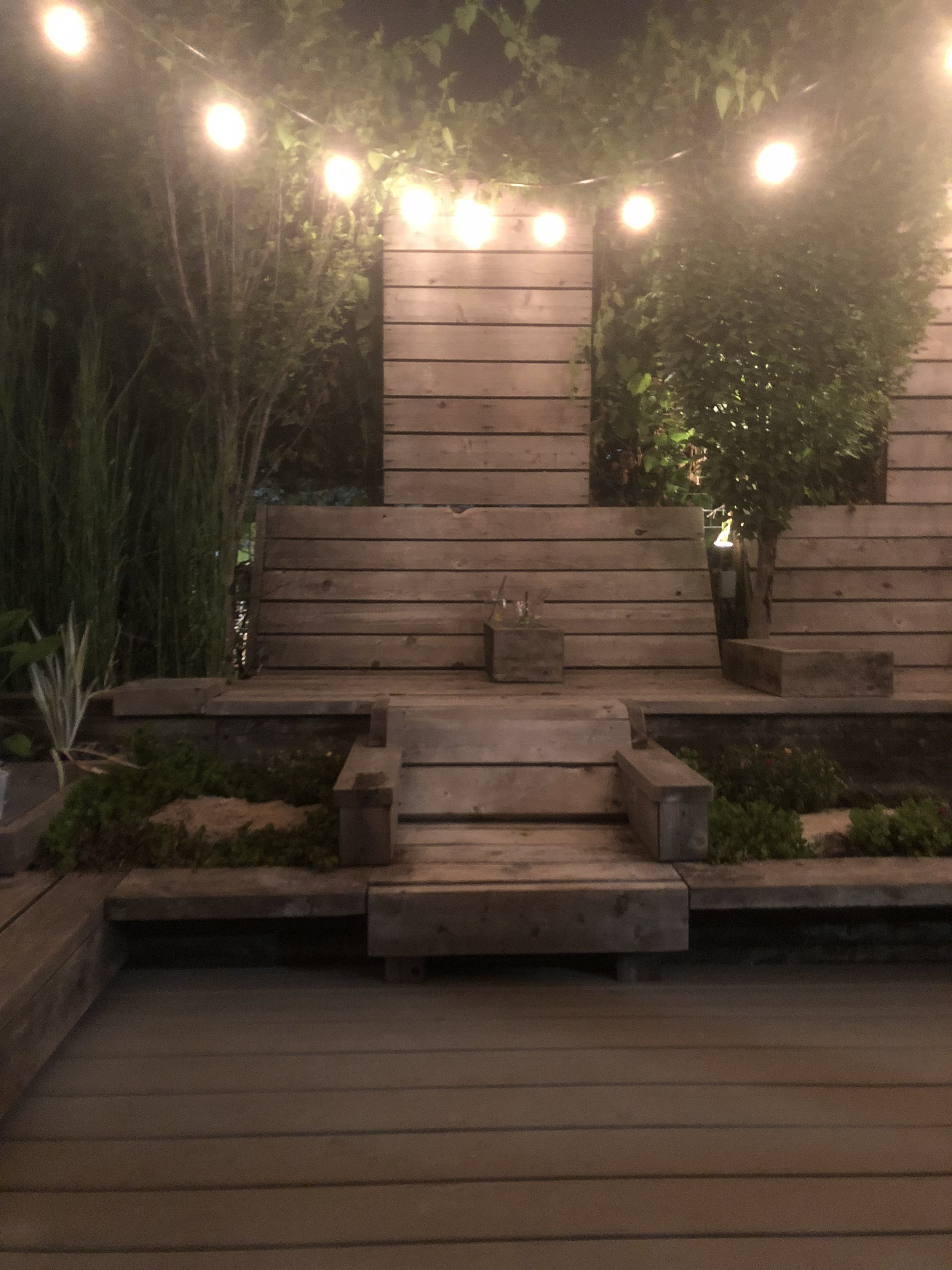 The cozy, dreamy outdoor patio at the Greenhouse Bar.