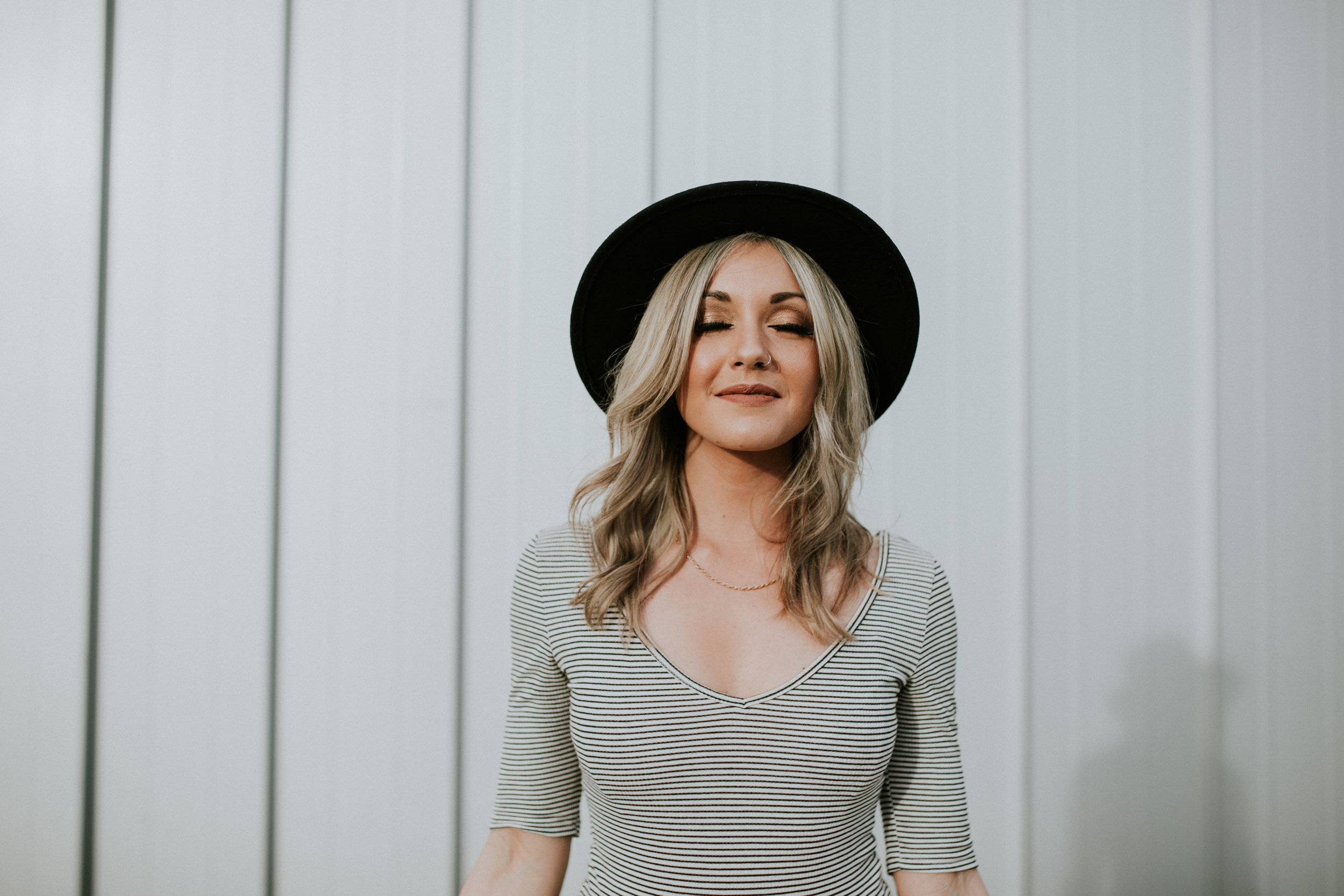 Chelle Morgan Vancouver blogger in striped shirt and hat looking at the sun