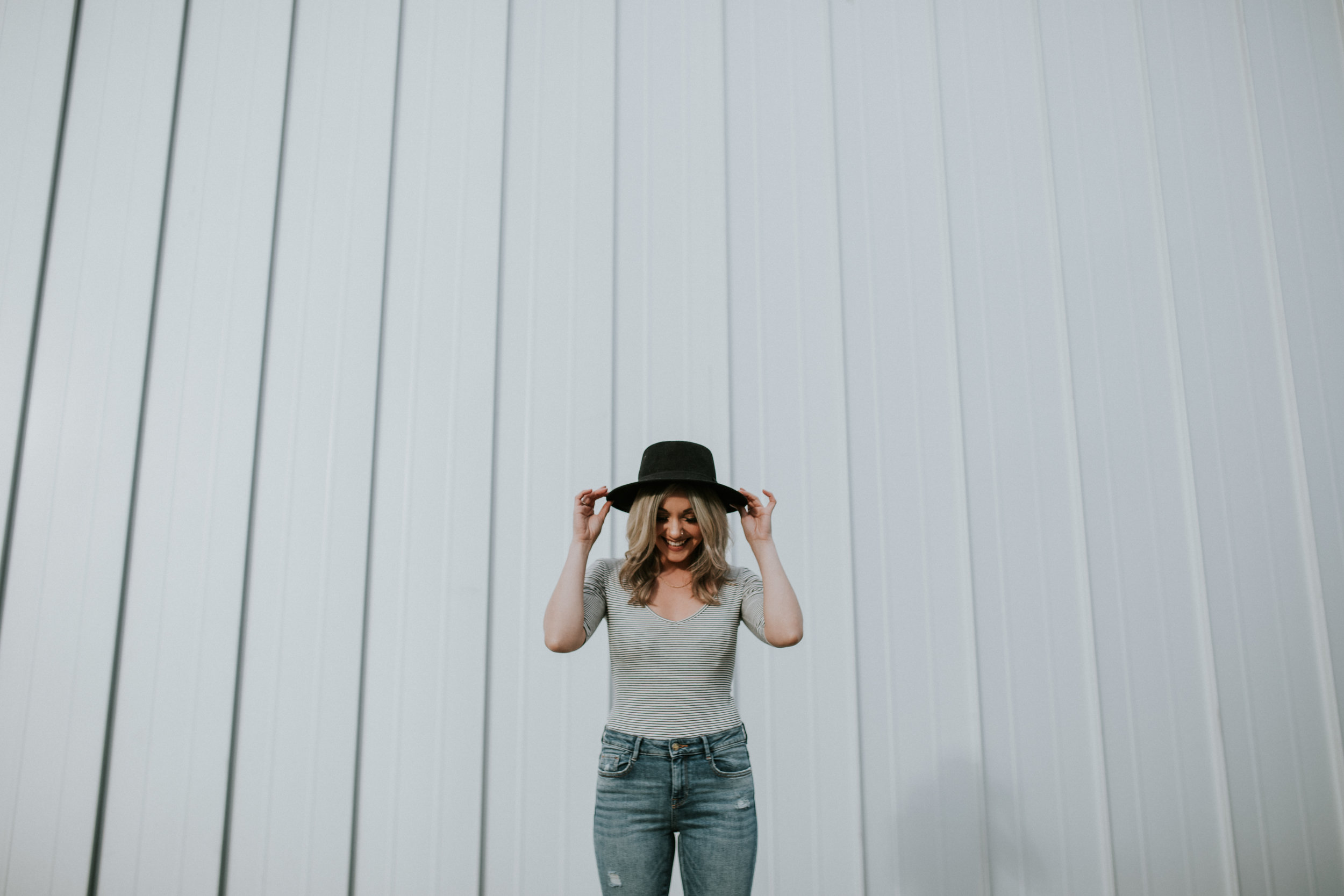 Chelle Morgan Vancouver blogger smiling in black hat, striped top and jeans