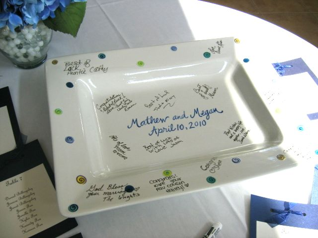 Pre-Finished Guestbook Signature Platter being signed at the event.