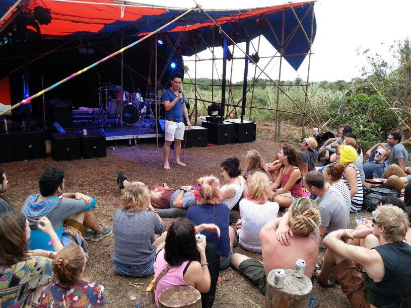 Performing barefoot at the Hush Up Secret Island Party. Hundreds of hippies, and later a baby walks on stage.