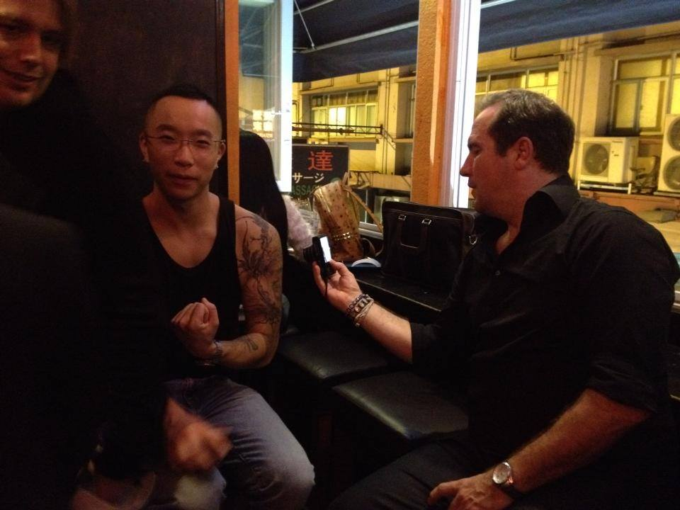 The true world travelling comic, Tom Rhodes, being a little obsessed with Tamby's tattoos