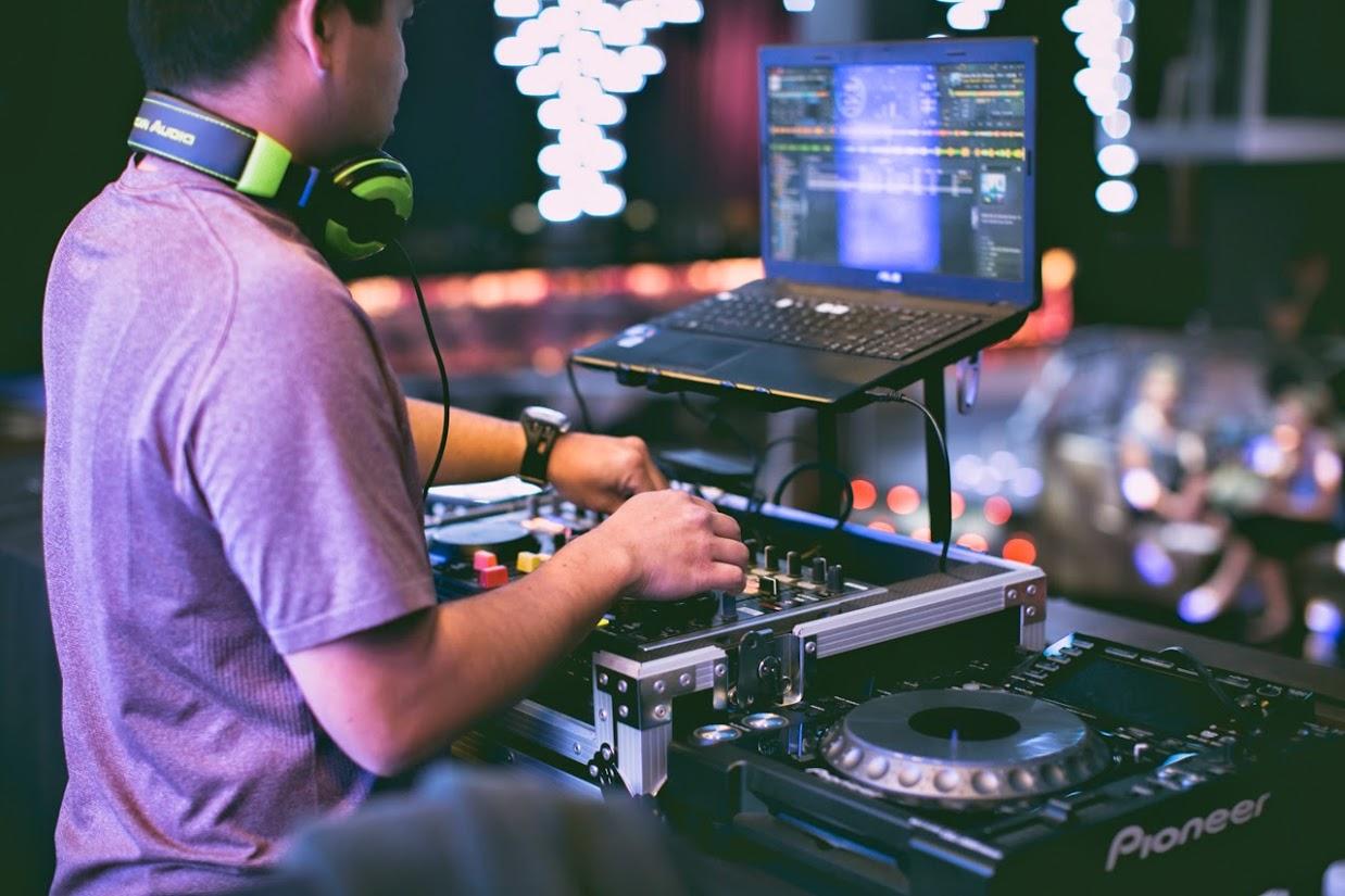San Diego DJ, Justin Kanoya, plays music for a yoga session at Parq San Diego.