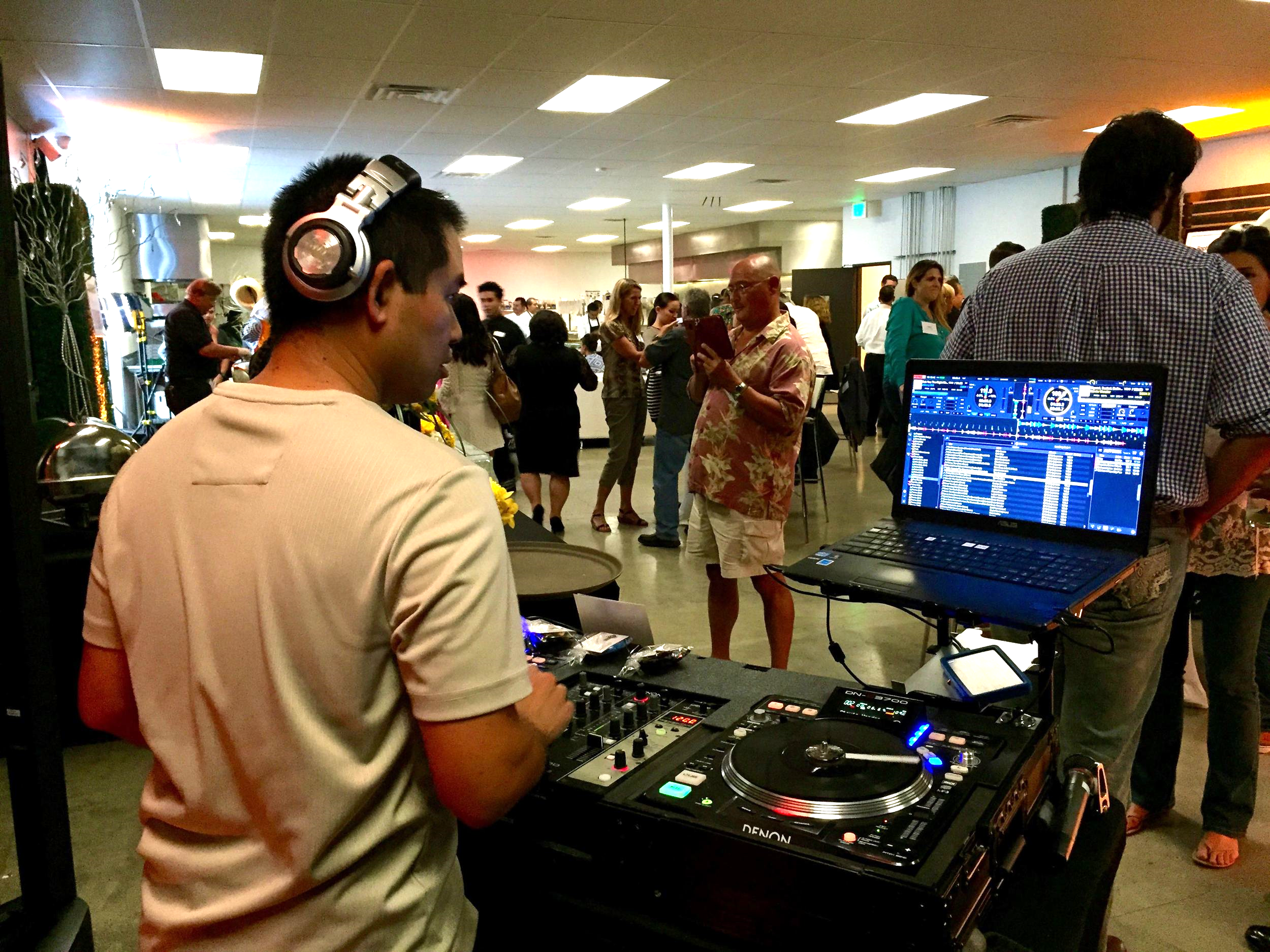 DJ Justin Kanoya provides live DJ service at the Brothers Signature Catering and Events grand opening party in San Diego, California.