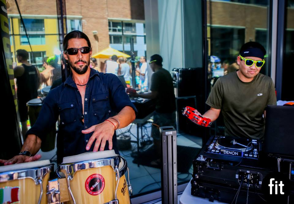 DJ Justin Kanoya jams with Bruno Serrano at the FIT Athletic Downtown San Diego pool party that took place on July 25, 2015.