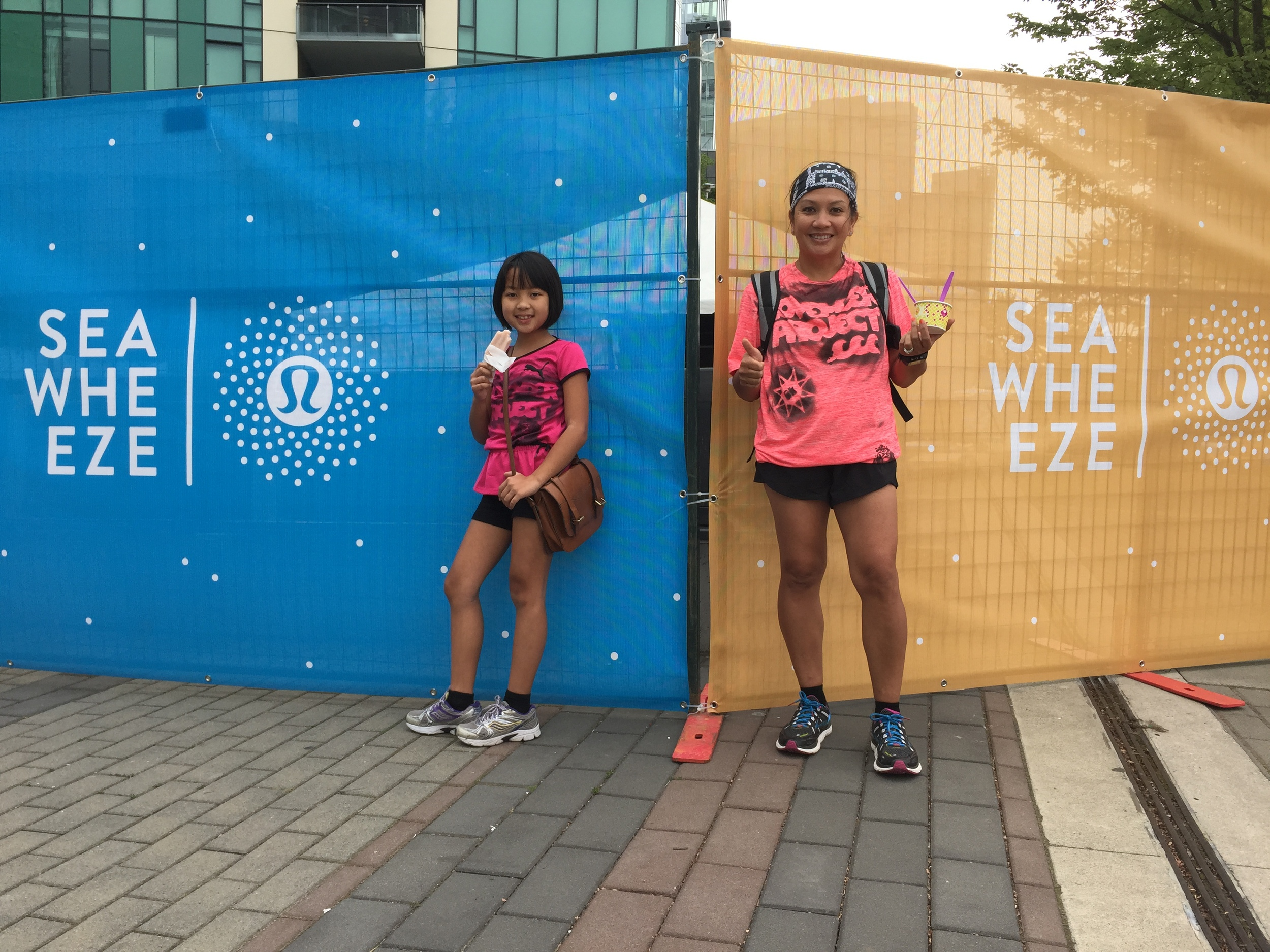 My wife and daughter enjoy frozen treats at the 2015 Seawheeze Half Marathon race expo.