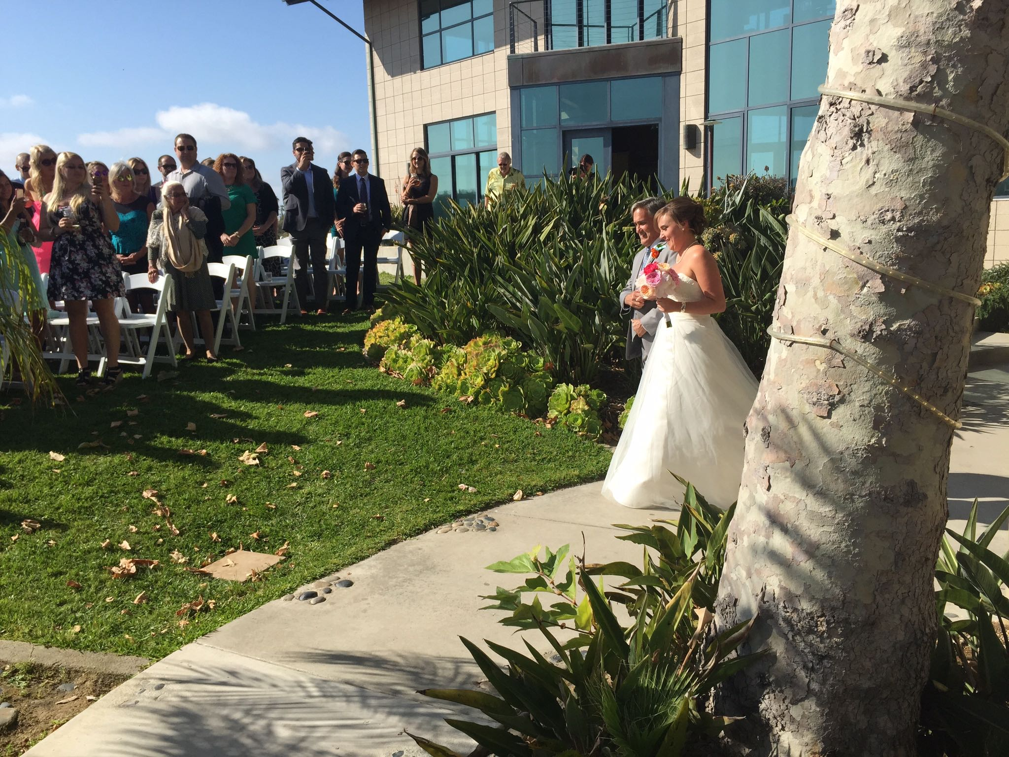 Dad walking daughter down the aisle at Levyland Estates in Carlsbad, California.