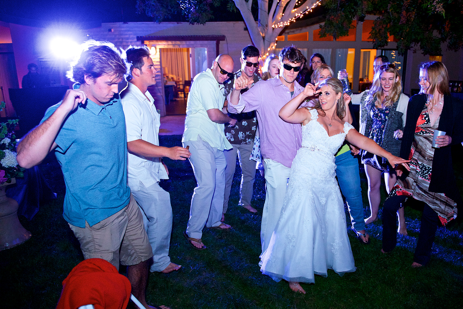 Megan and Trevor dance with friends and family at their Paradise Point wedding in San Diego.