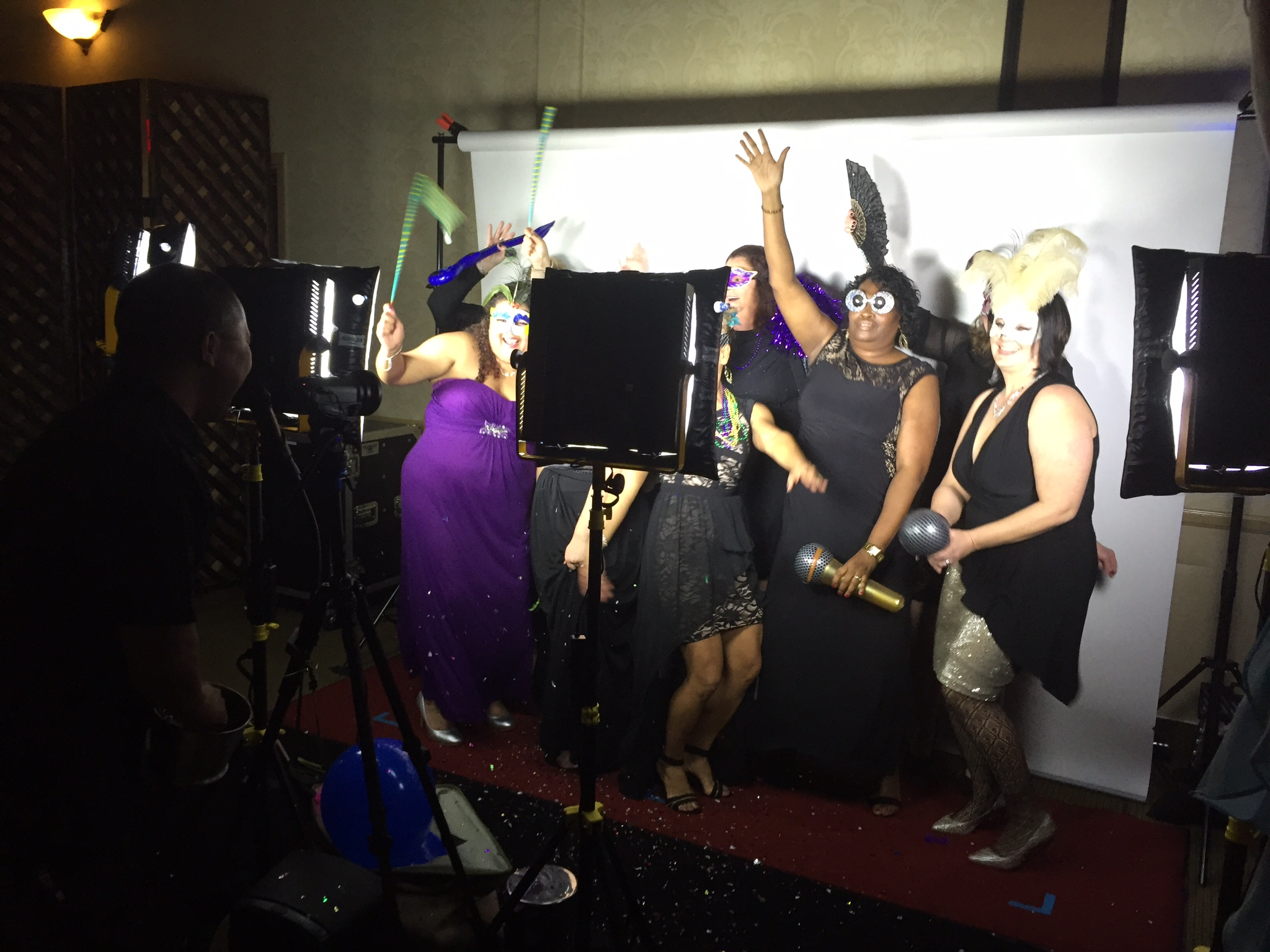 Pacific Marine Credit Union employees enjoy time in the video booth provided by DJ Kanoya Productions.The company's holiday party took place at South Coast Winery in Temecala, CA.