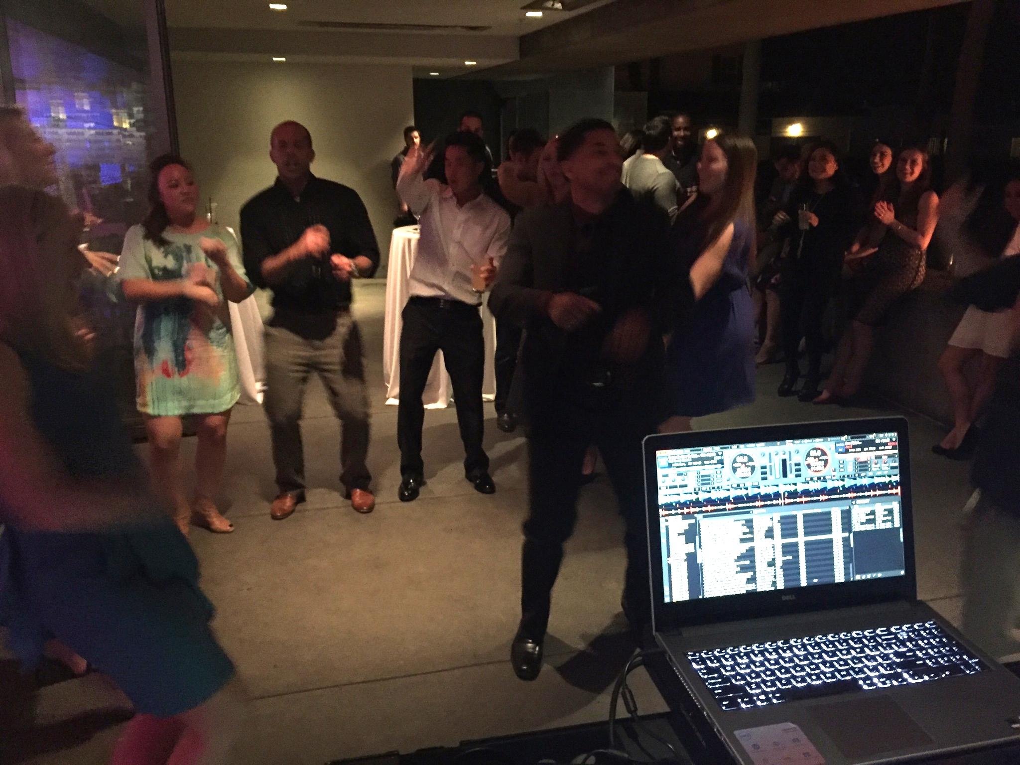 Proven Recruiting employees and their guests dance to the beat of DJ Justin Kanoya.