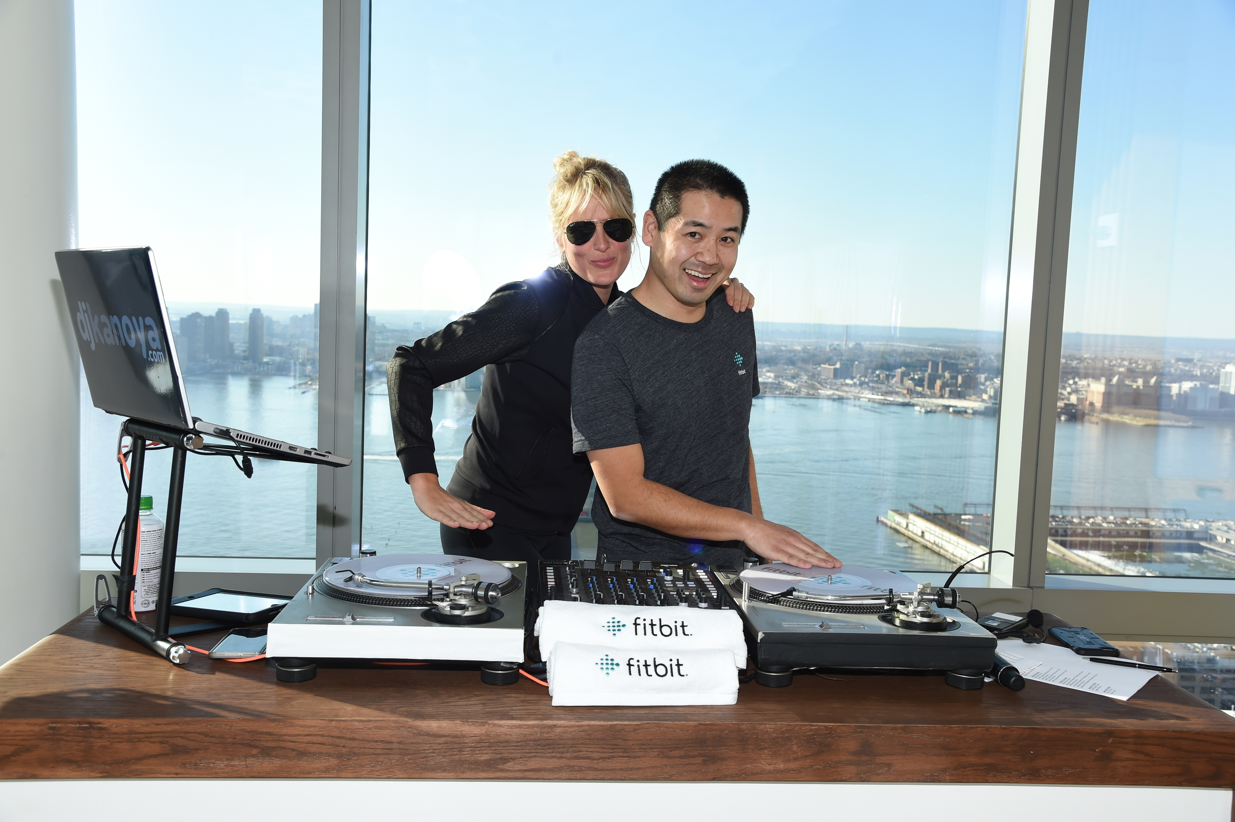 Celebrity stylist, Anita Patrickson, in the DJ booth with San Diego DJ, Justin Kanoya.