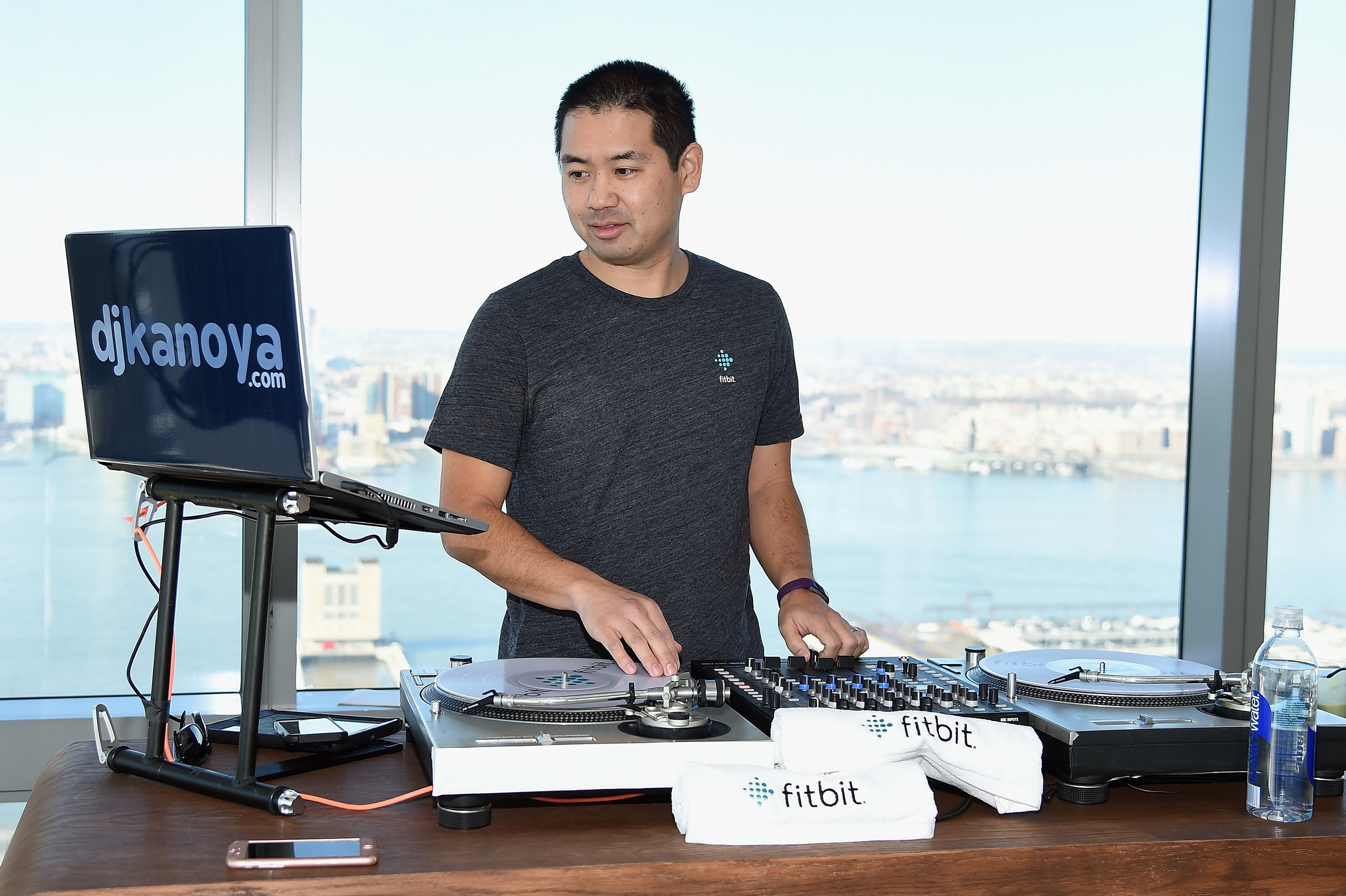 San Diego DJ, Justin Kanoya, plays a hip-hop music set for the Fitbit Alta product launch and workout led by Harley Pasternak.