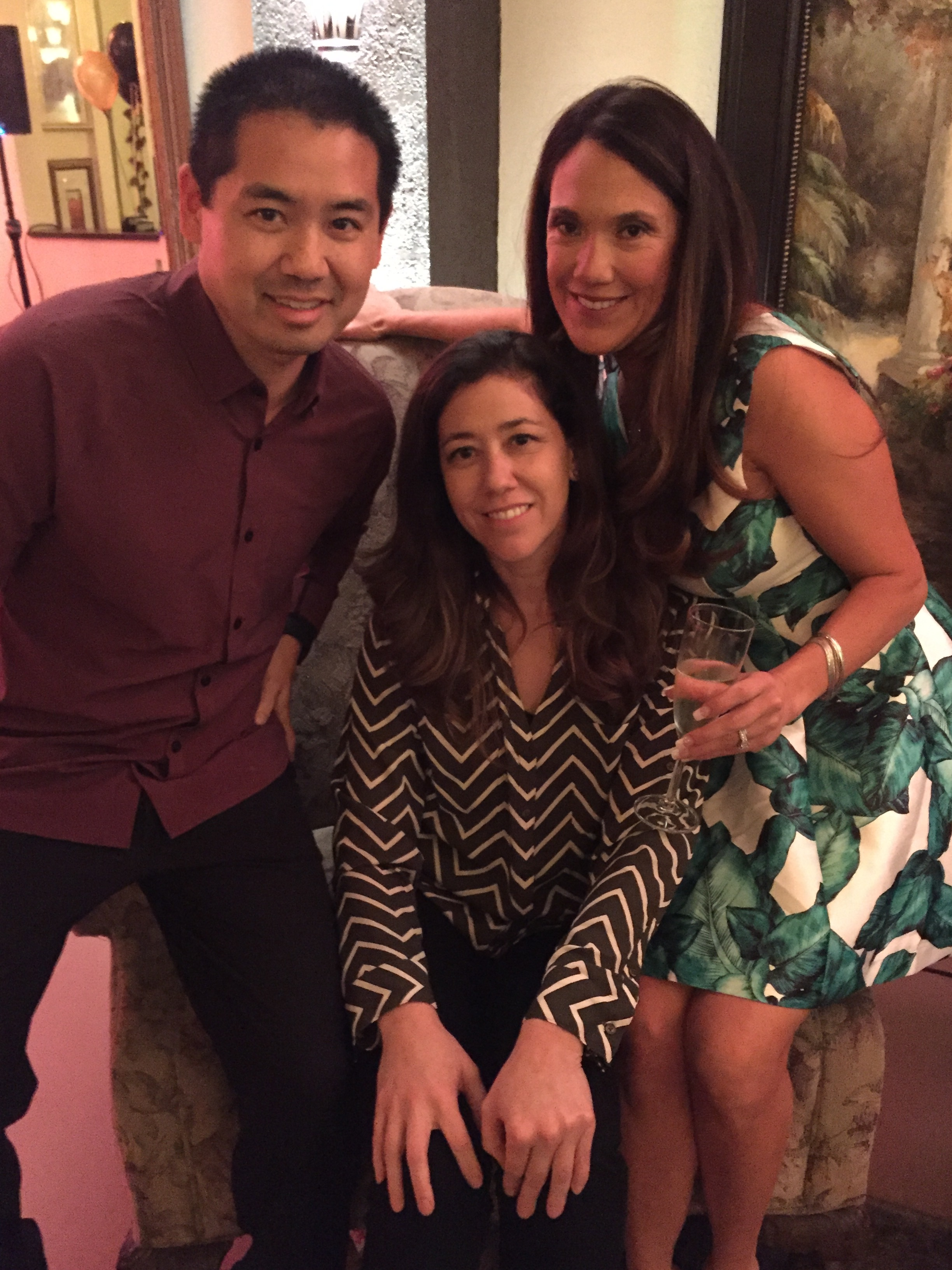 San Diego, Justin Kanoya, with party host Felicia (right) and her sister, Allison (middle).