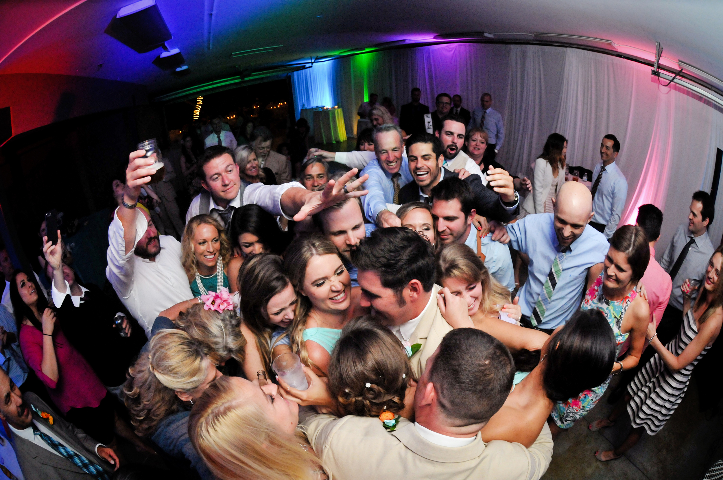 Your last dance should be punctuated by moments like this, your friends and family all surrounding you and your new bride/groom in one big group hug.