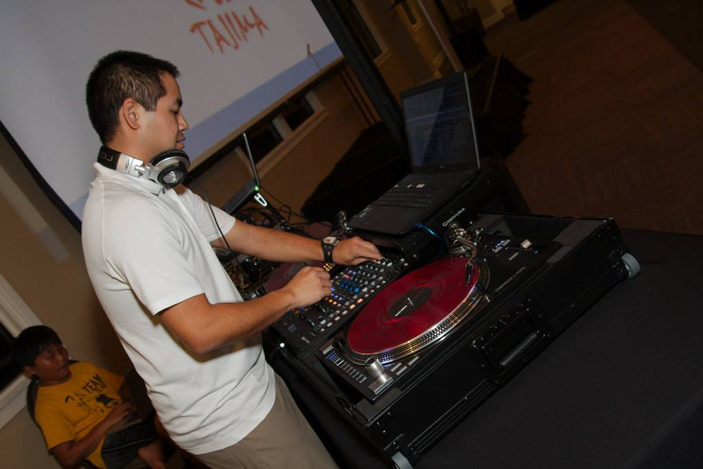 San Diego DJ Justin Kanoya spins tunes at Chew the Scene, the kick off event for the 2015 San Diego Asian Film Festival.