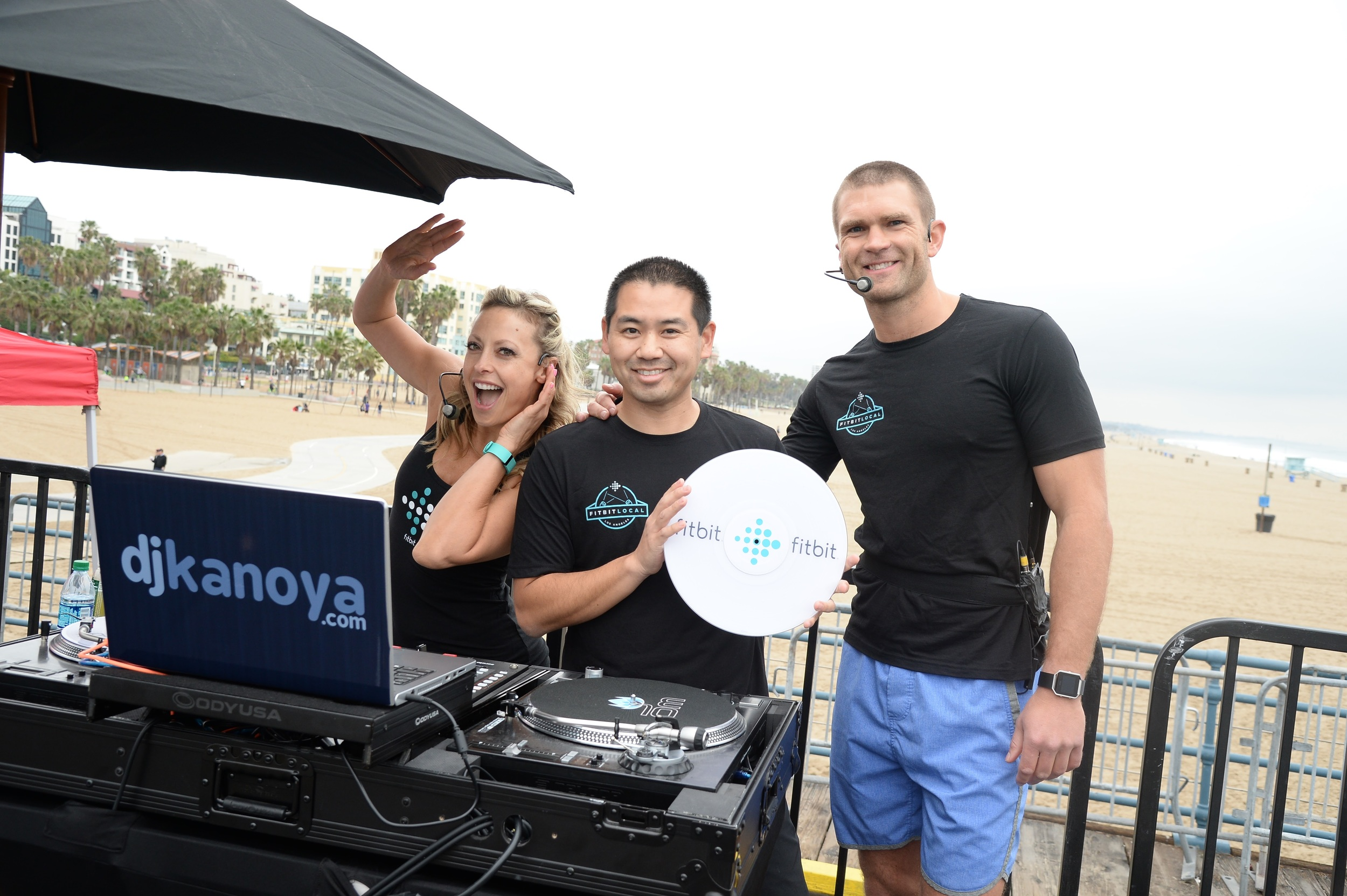 DJ Justin Kanoya provides the beats for the Fitbit Local event in Santa Monica.