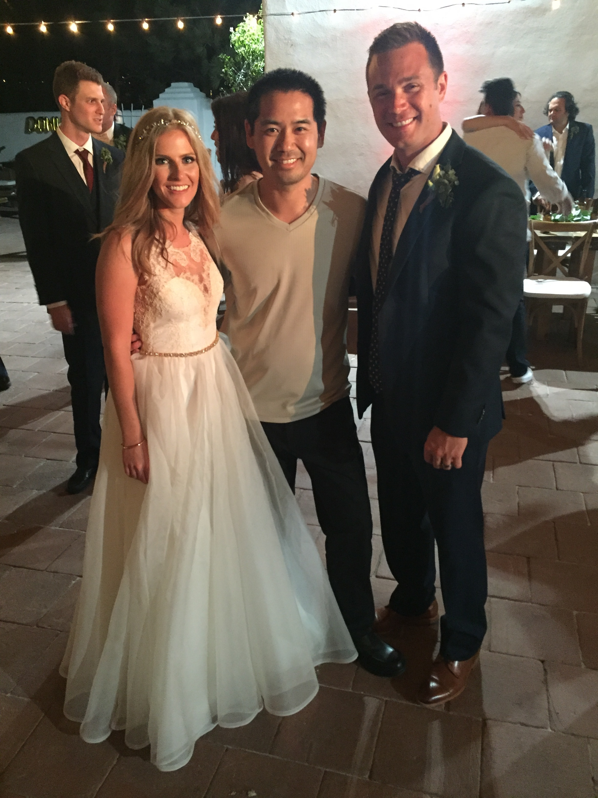 San Diego DJ Justin Kanoya with the bride and groom, Ashley and Chad, after their wedding at the Historic Cottage