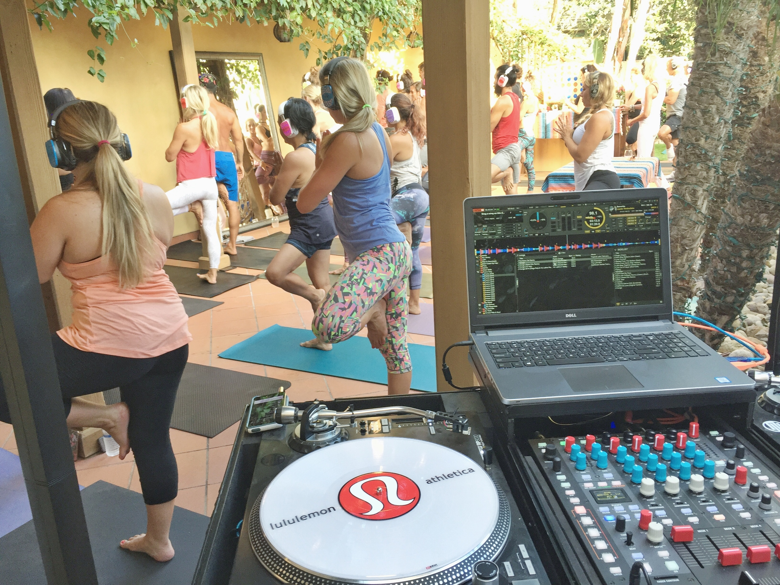 Shhh, we're doing silent yoga. Attendees experience yoga while music and instructions are piped through their headphones. San Diego yoga and fitness DJ, Justin Kanoya, spun the tunes for this event.