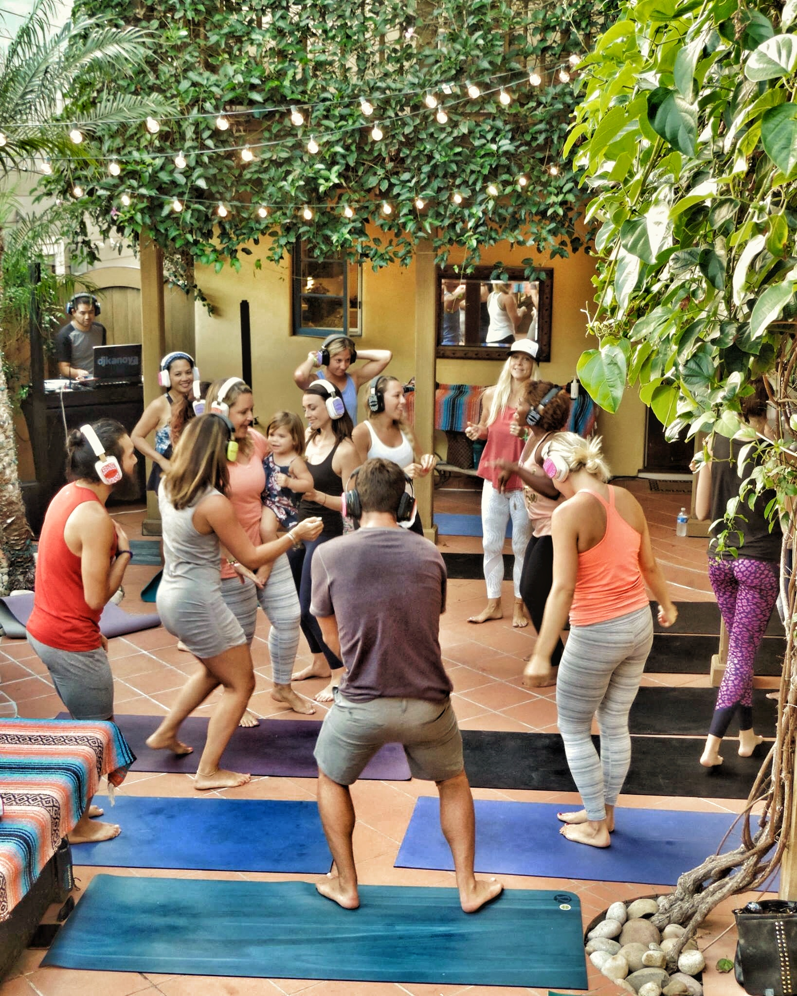 From a yoga flow to a dance party. Attendees at the Lululemon Residency event in San Diego experience the silent disco phenomenon. San Diego yoga and fitness DJ, Justin Kanoya, spun tunes for the event.