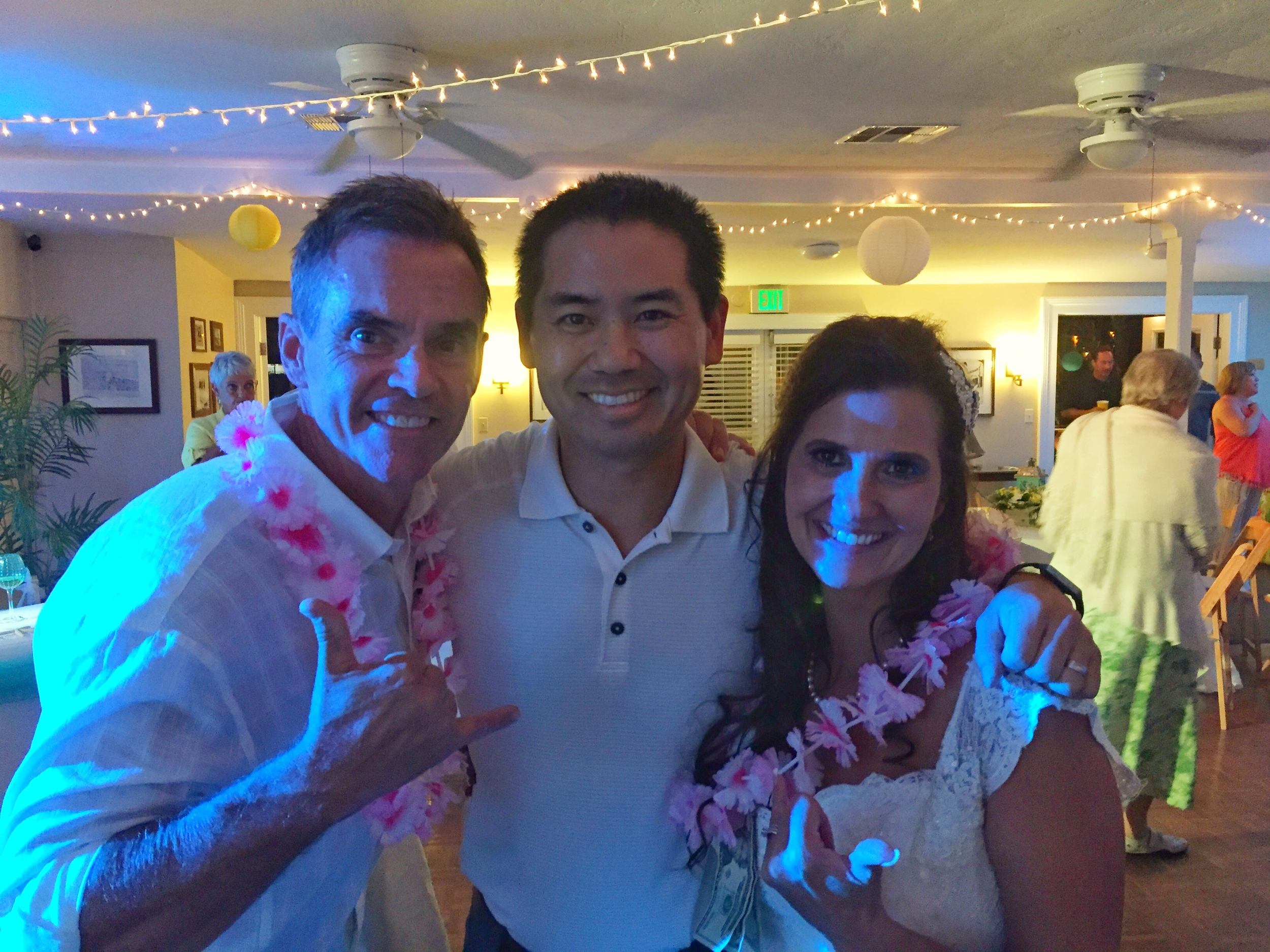 Tim and Gina with San Diego DJ Justin Kanoya at their wedding at the Mission Beach Women's Club.