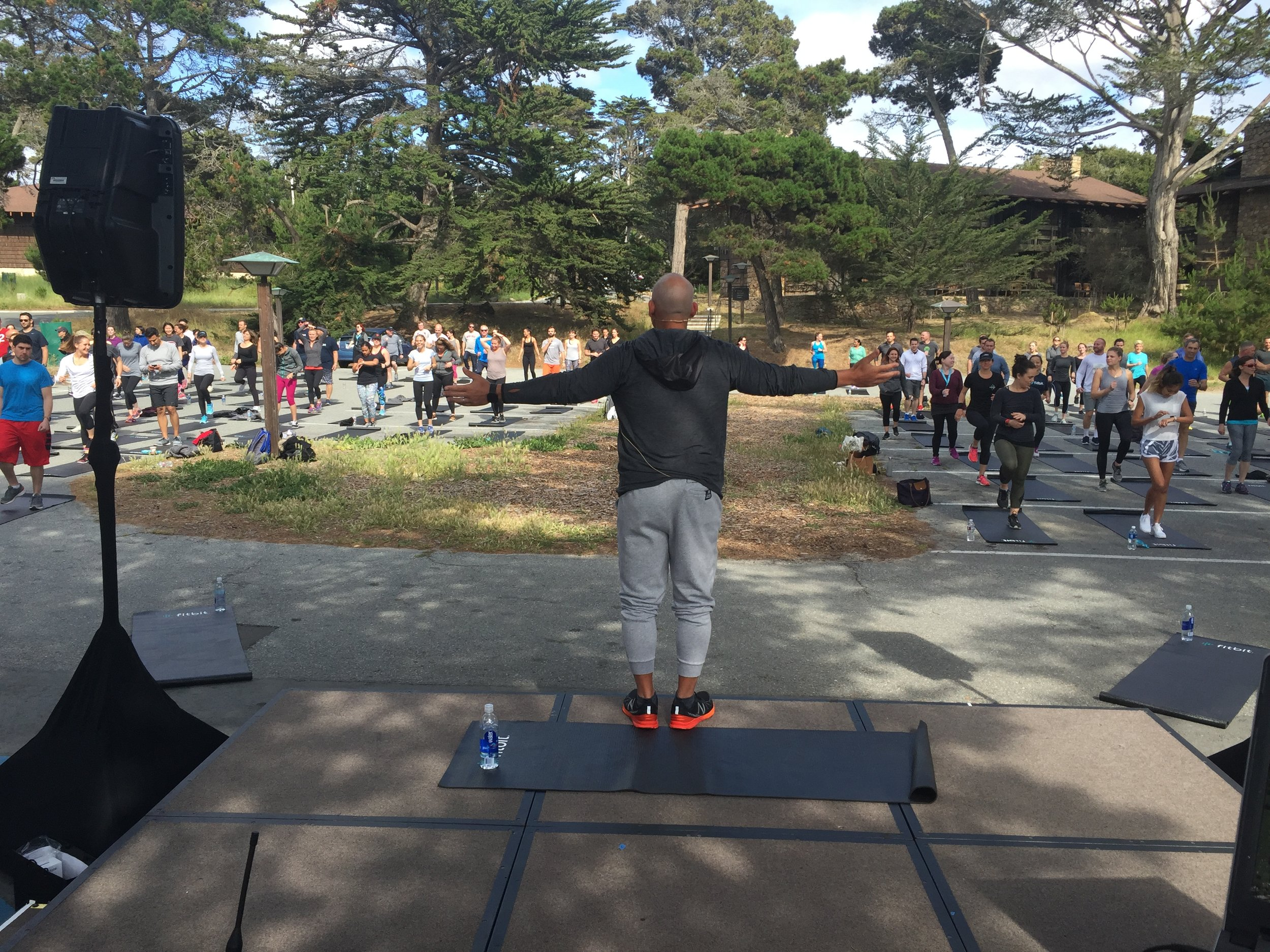 Celebrity trainer Harley Pasternak leads a Fitbit employee workout.
