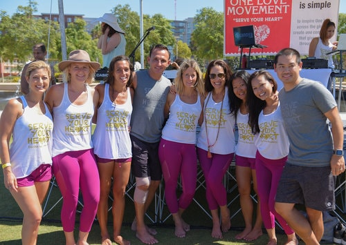 San Diego yoga DJ Justin Kanoya, with yoga teachers at the One Love Movement yoga event in San Diego on September 24, 2016.