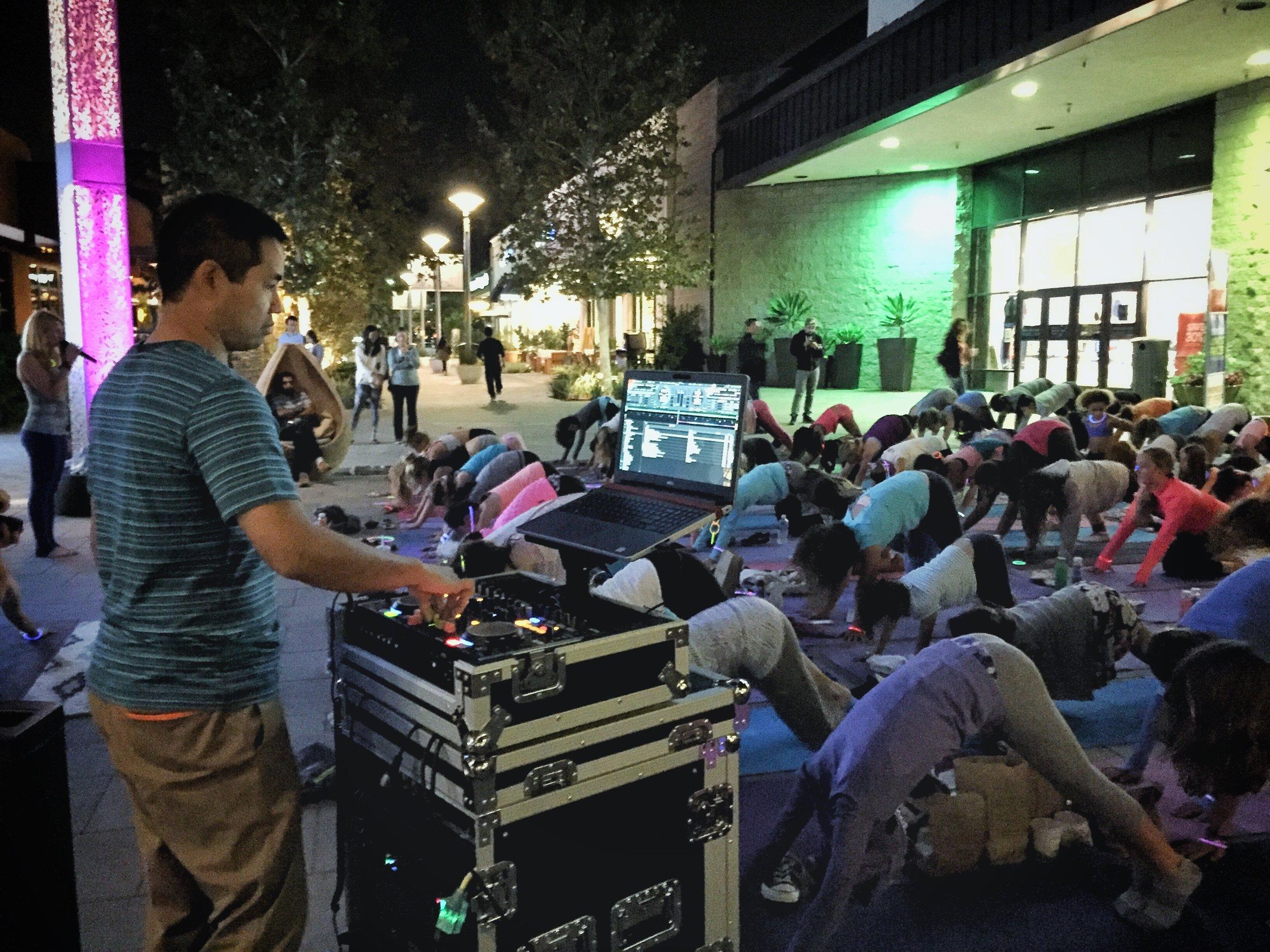 San Diego based yoga DJ Justin Kanoya DJ's the Flow in the Dark event at Westfield UTC.