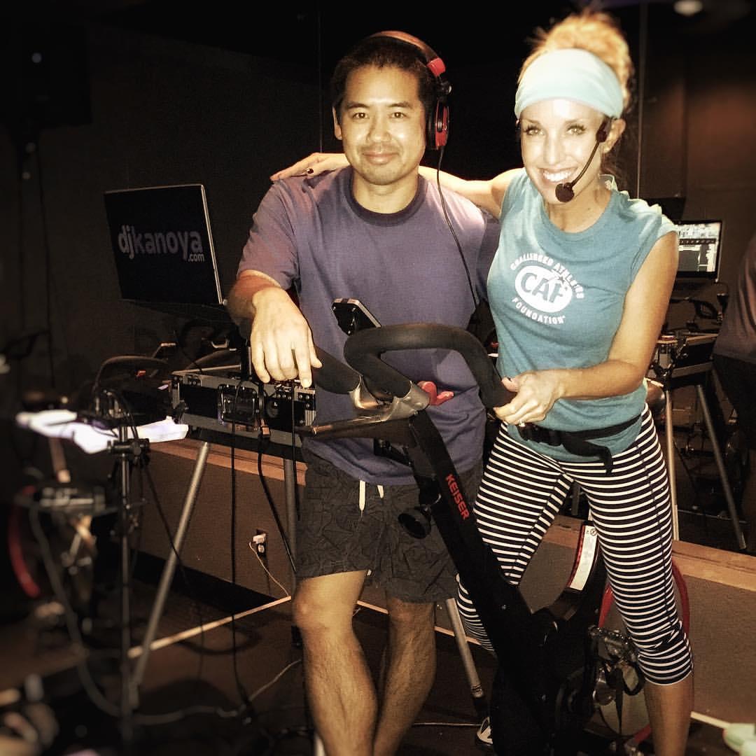 Fitness DJ Justin Kanoya, with corporate wellness professional and spin instructor, Sheri Matthews.