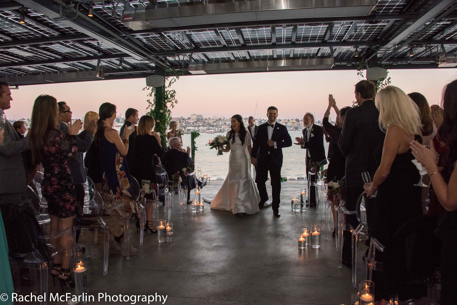 """Danny and Stefanie walk down the aisle after saying """"I Do"""" at their wedding at Coasterra on San Diego Bay."""