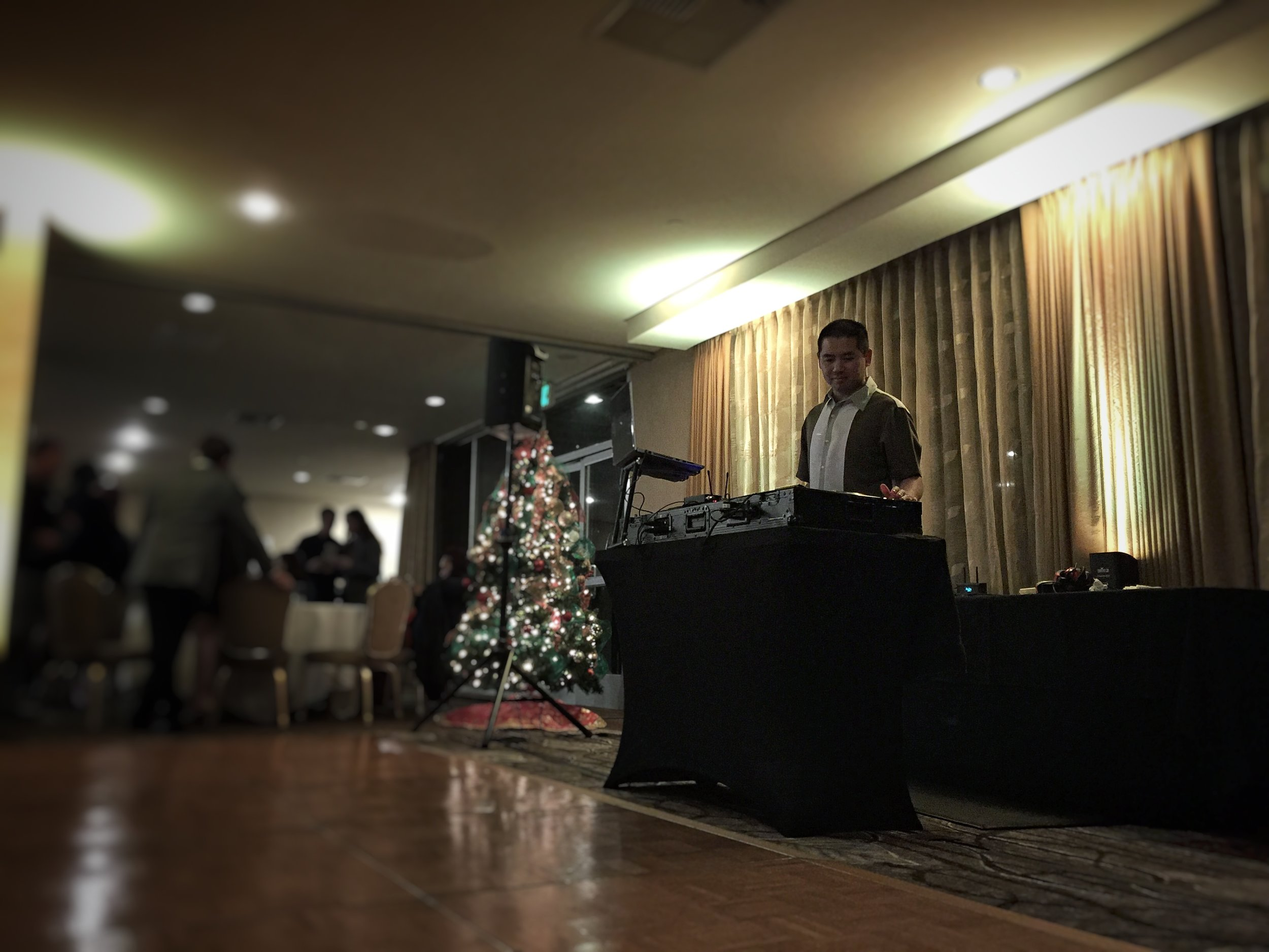 San Diego DJ Justin Kanoya plays music at the Aaron Price Fellows holiday party.