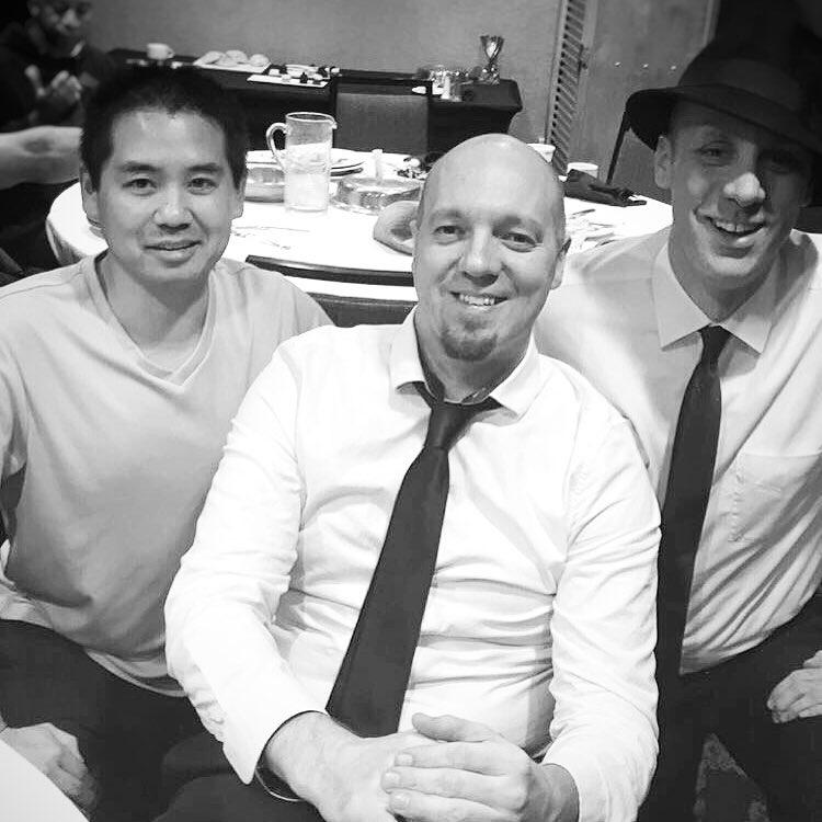 DJ Justin Kanoya with members of Pop Vinyl, Brian Hogan and Aaron Erlichmann
