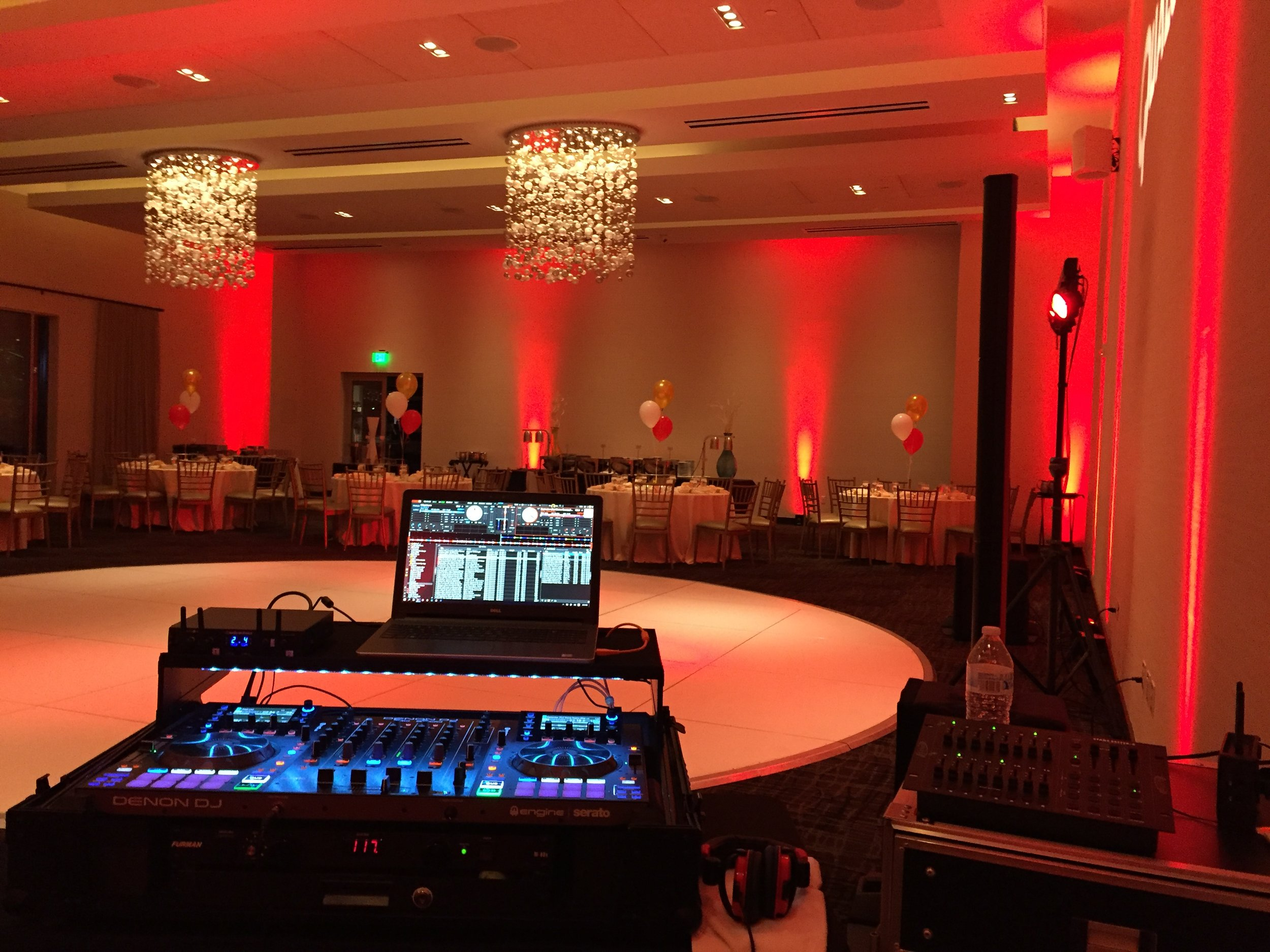 DJ Justin Kanoya is set-up with uplighting at Coasterra for a Qualcomm holiday party.