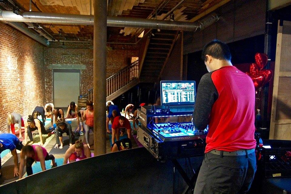 San Diego based yoga DJ, Justin Kanoya, spins at Yoga on Tap, an event held at Mission Brewery on February 14, 2017.