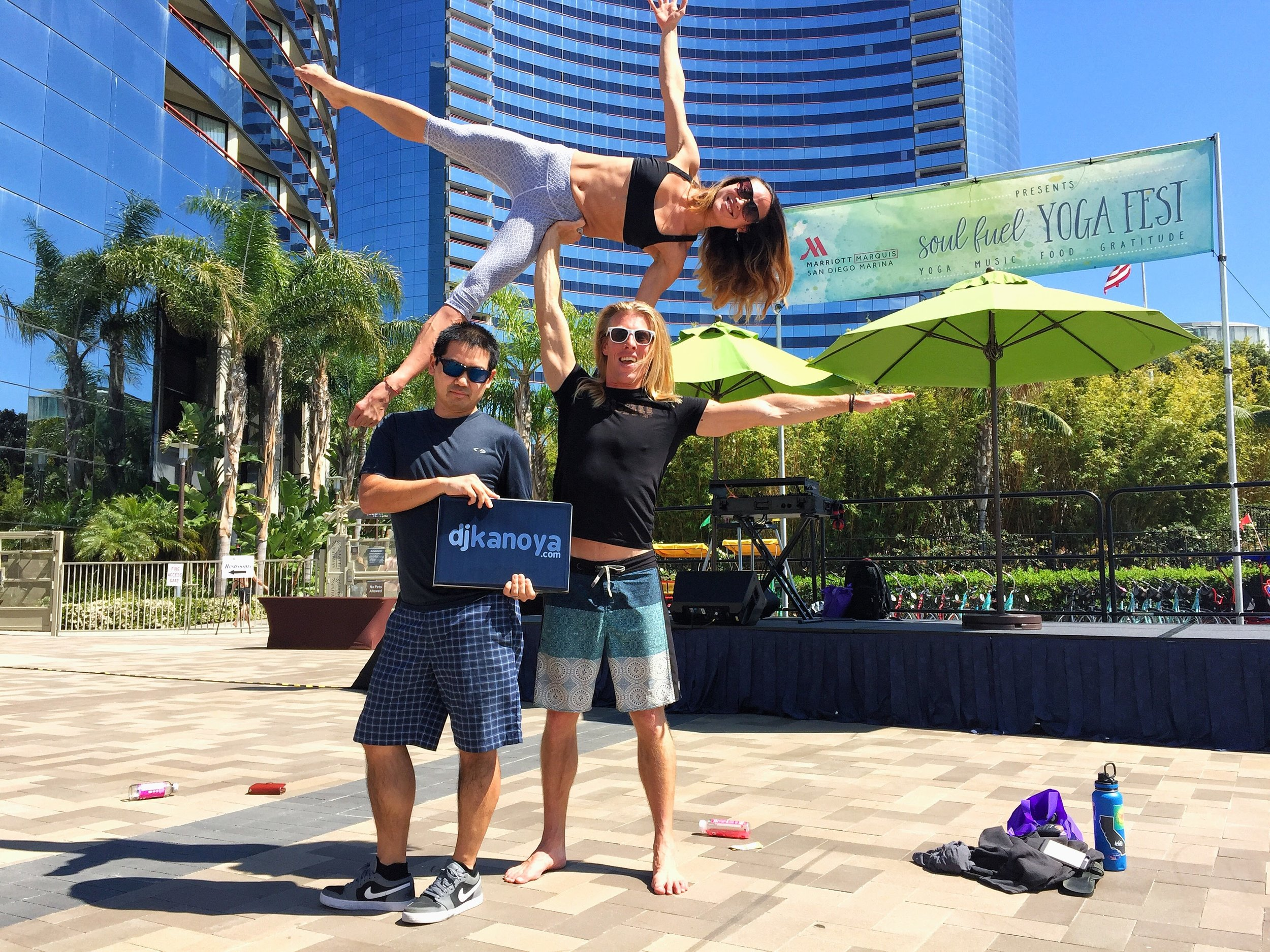 San Diego yoga DJ justin Kanoya poses with acroyoga performers Steven Cumming and Gina Shiotani at the Soul Fuel Yoga Fest.