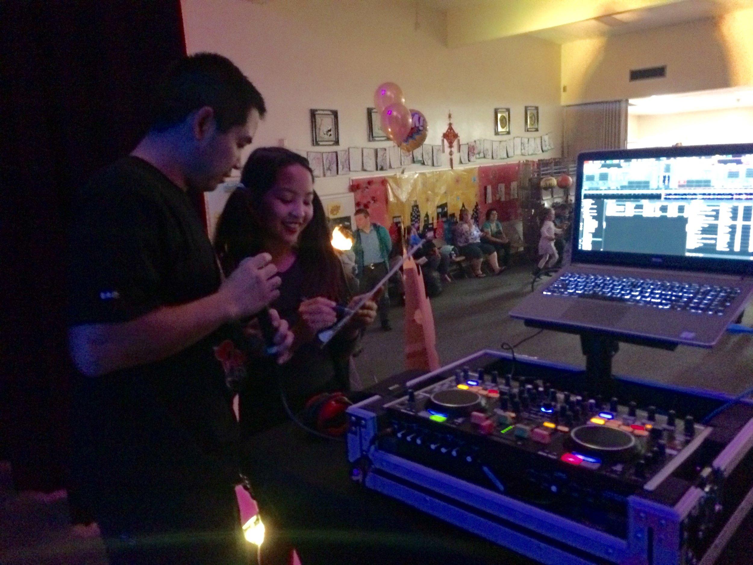 San Diego Diego, Justin Kanoya, DJ's the Barnard Elementary School dance with some help from daughter, Marissa.