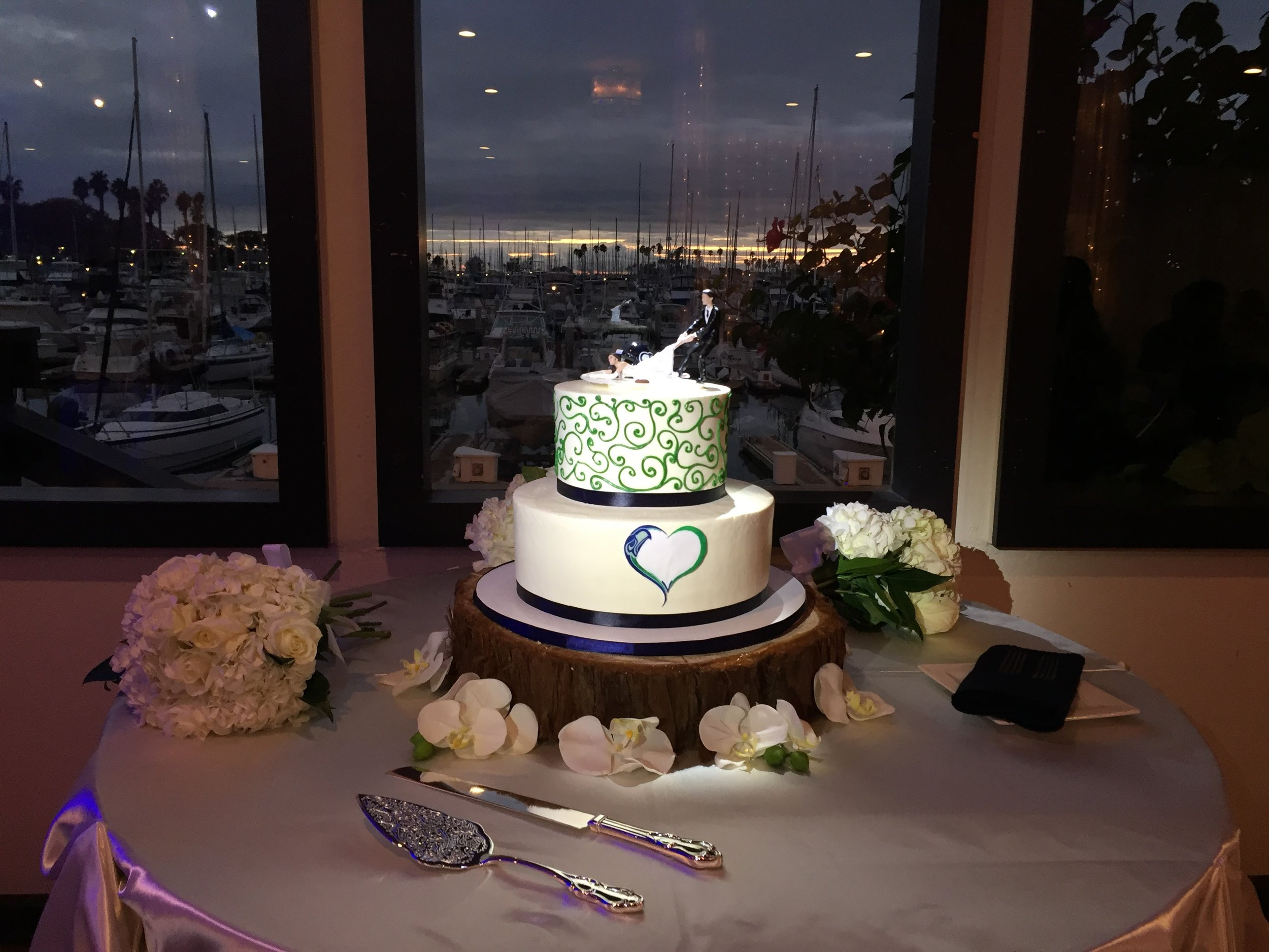 Joeleen and Mike's wedding cake colors were inspired by their fandom of the Seattle Seahawks.