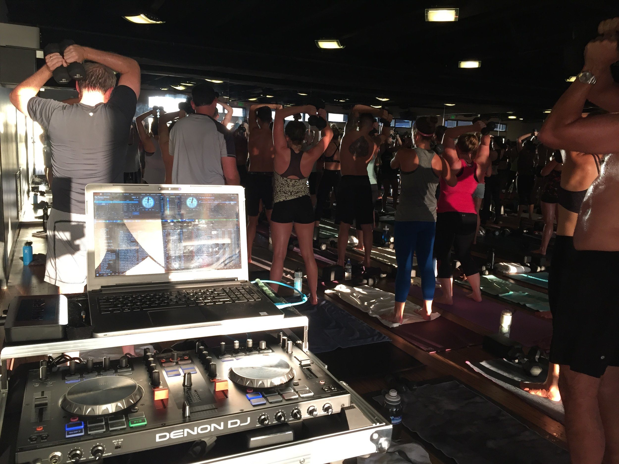 Corepower Yoga members dance and sweat at a Yoga Sculpt class taught by Katie Burke and DJ'd by Justin Kanoya.