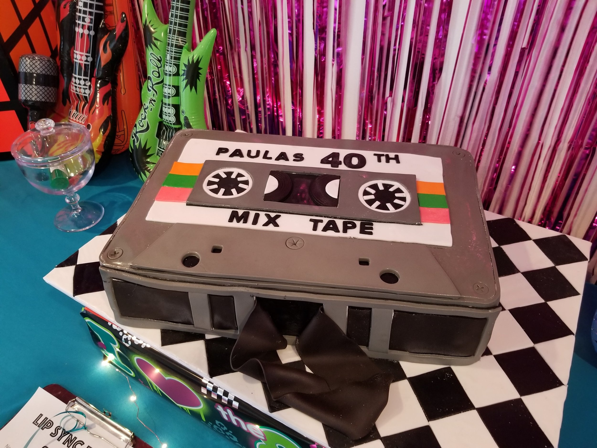 Who made mixtapes back in the day? But did you ever make a mixtape cake?? This was the perfect touch for Paula's 80s themed birthday party.