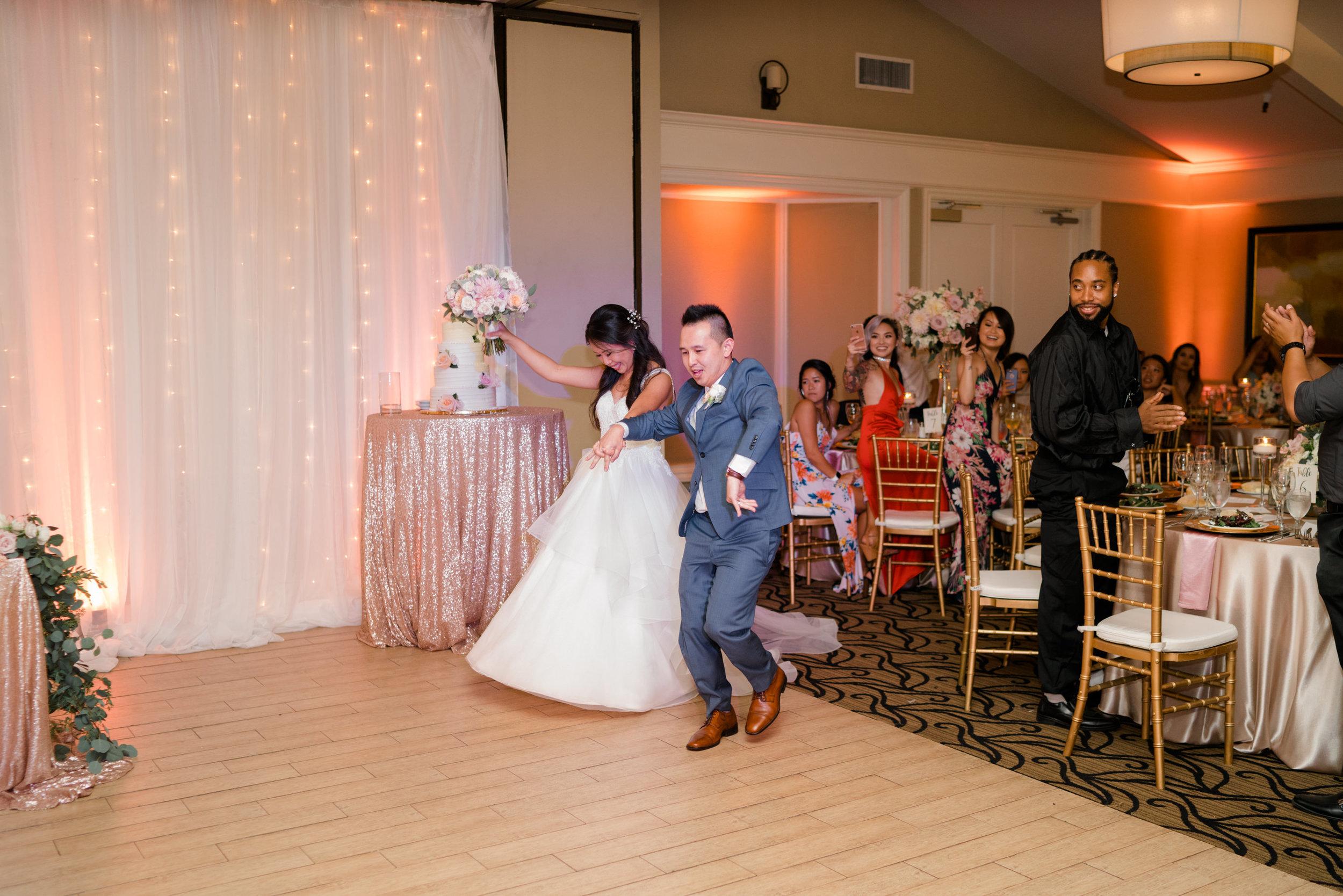 Maria and Nicholas enter their wedding reception at Morgan Run resort.