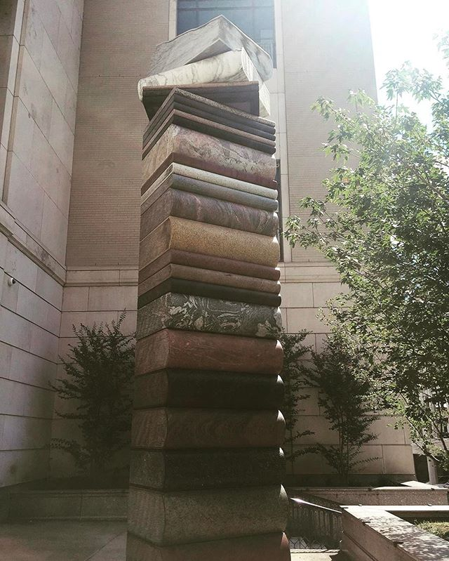 """""""La Storia della Terra (The Story of the Earth) is a 20-foot tower of stone books. The sculpture was created near Mainz, Germany. There are 26 books, one for each letter of the English alphabet. The granite, marble, and quartz stones originate from five continents."""" - Nashville Public Library 📚  I took this photo in September. The pile of 26 books is what I'd love to achieve reading this weekend, or every weekend #tbr"""