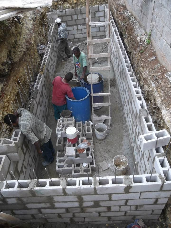 The community water cistern, built by Upward Ventures,  Practivistas DR  and the community of Las Malvinas, now provides the bottom half of the community with a steady source of water.