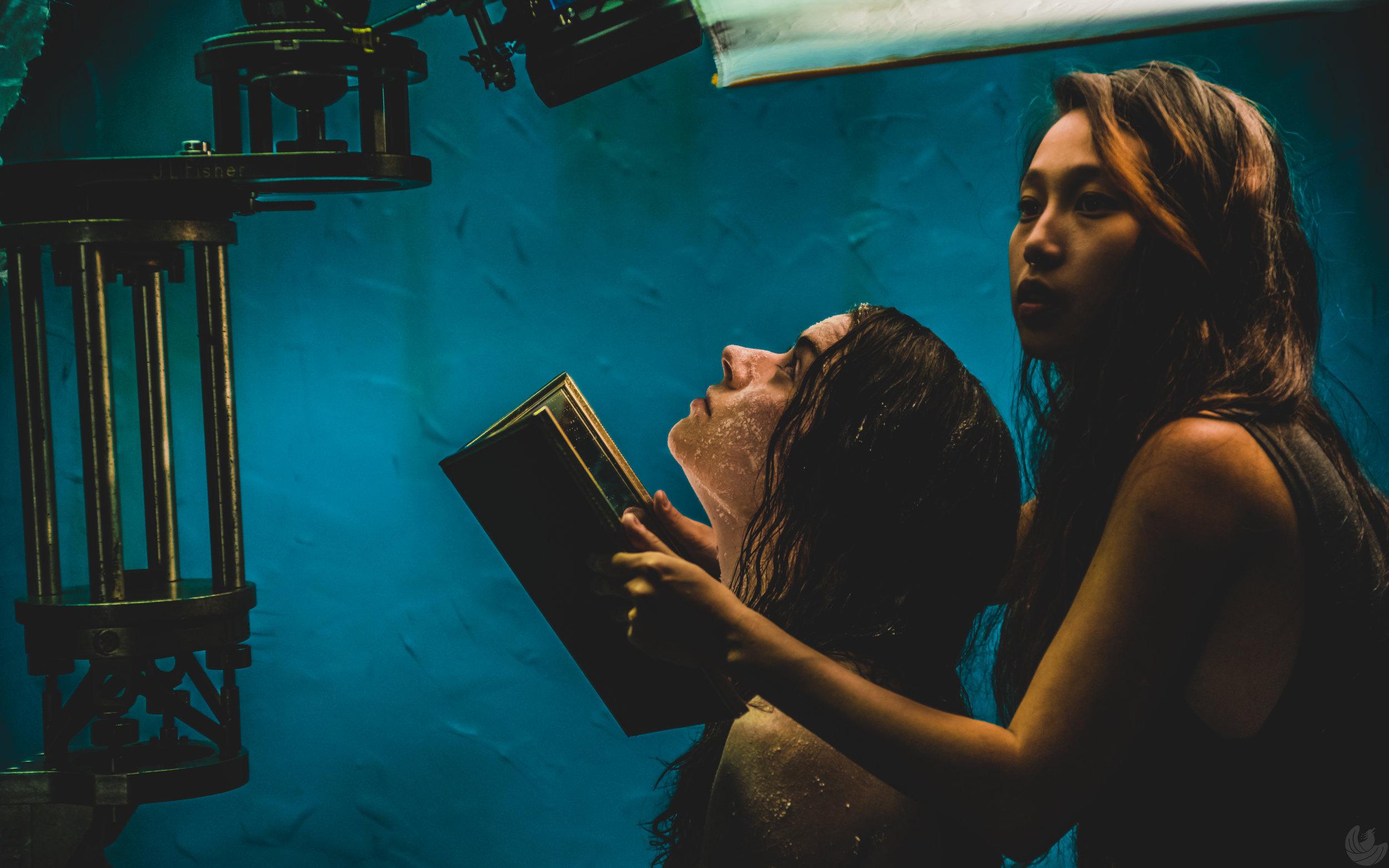 Maureen Renee Hughes, left, and director Joy Song frame up an overhead shot on the set of QUIETUS. (Oleg Bolotov/Auspicious Phoenix Productions)