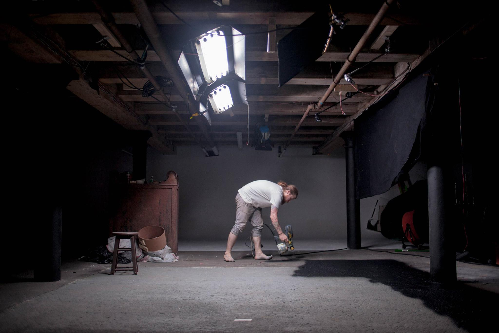 Cinematographer Jim DanDee paints the floor of The Space Studio black in preparation for the first day of production on LADIA. (Jim DanDee/Auspicious Phoenix Productions)