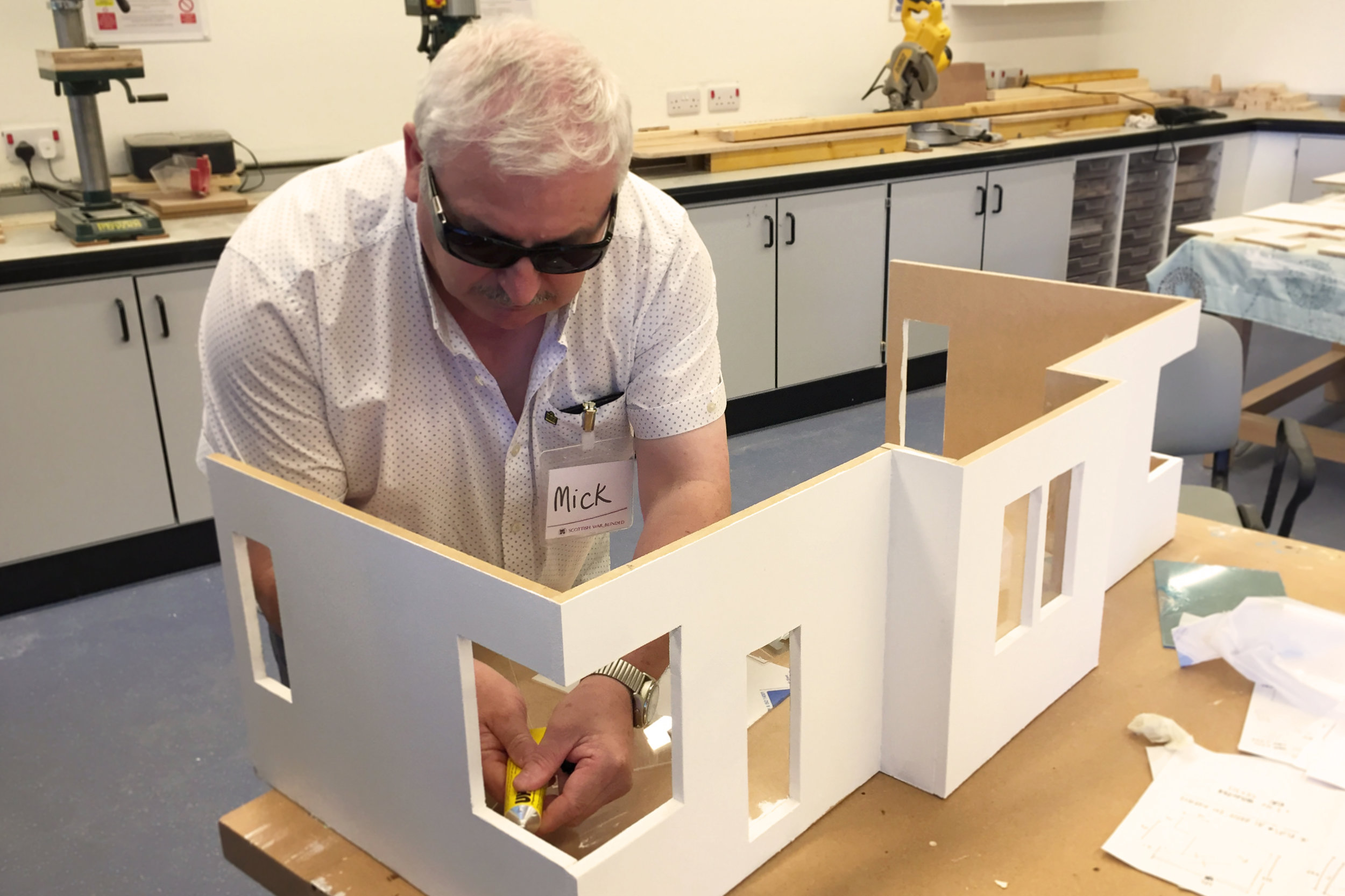 Mick at Scottish War Blinded working on the Janitor's House dolls house.