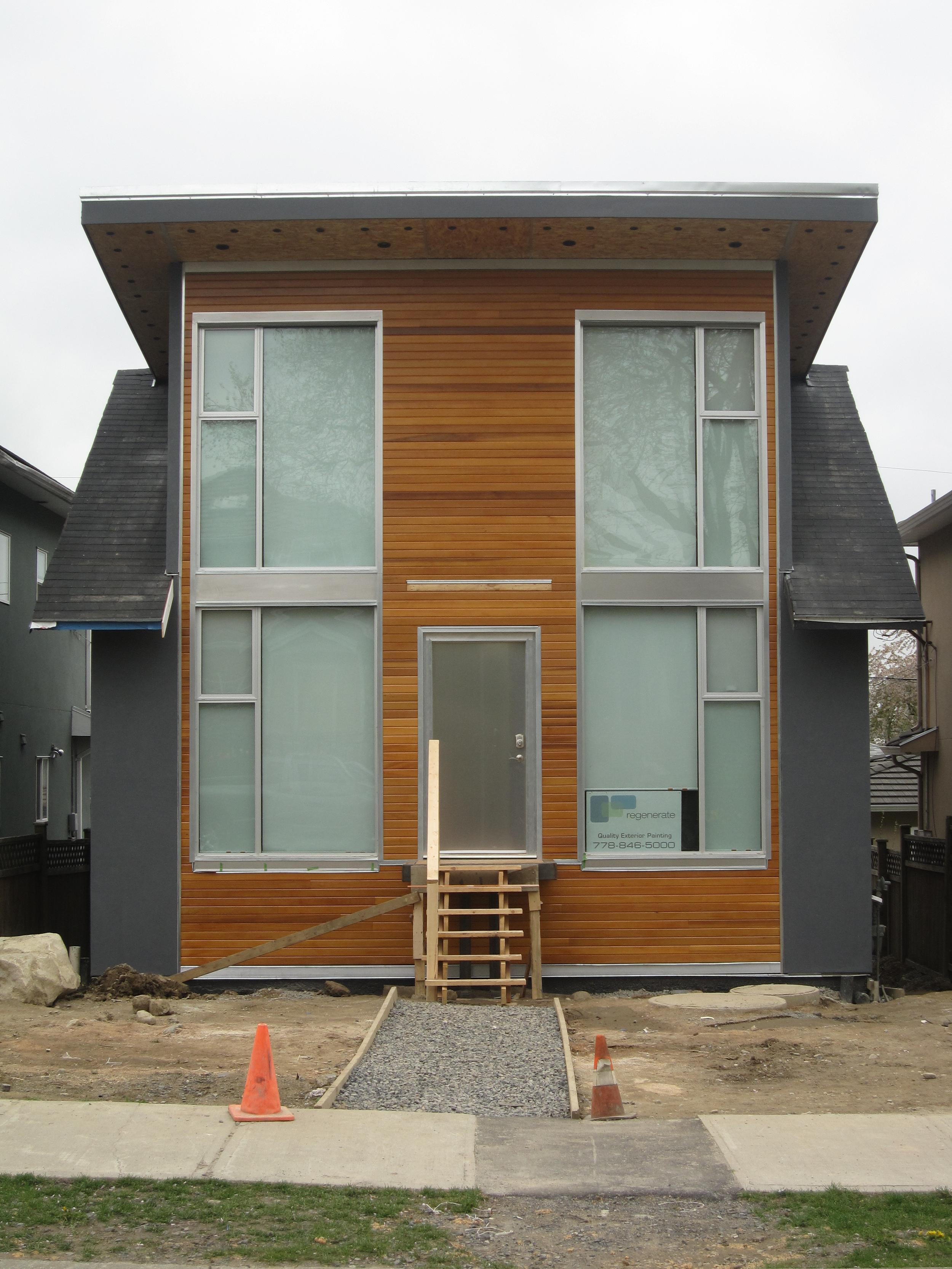 Regenerate Construction: Window Installation + Exterior Cladding