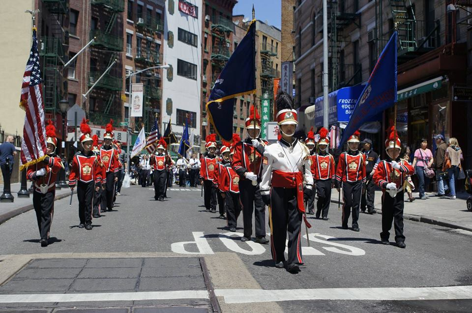 Marching down Mott Street in New York Chinatown