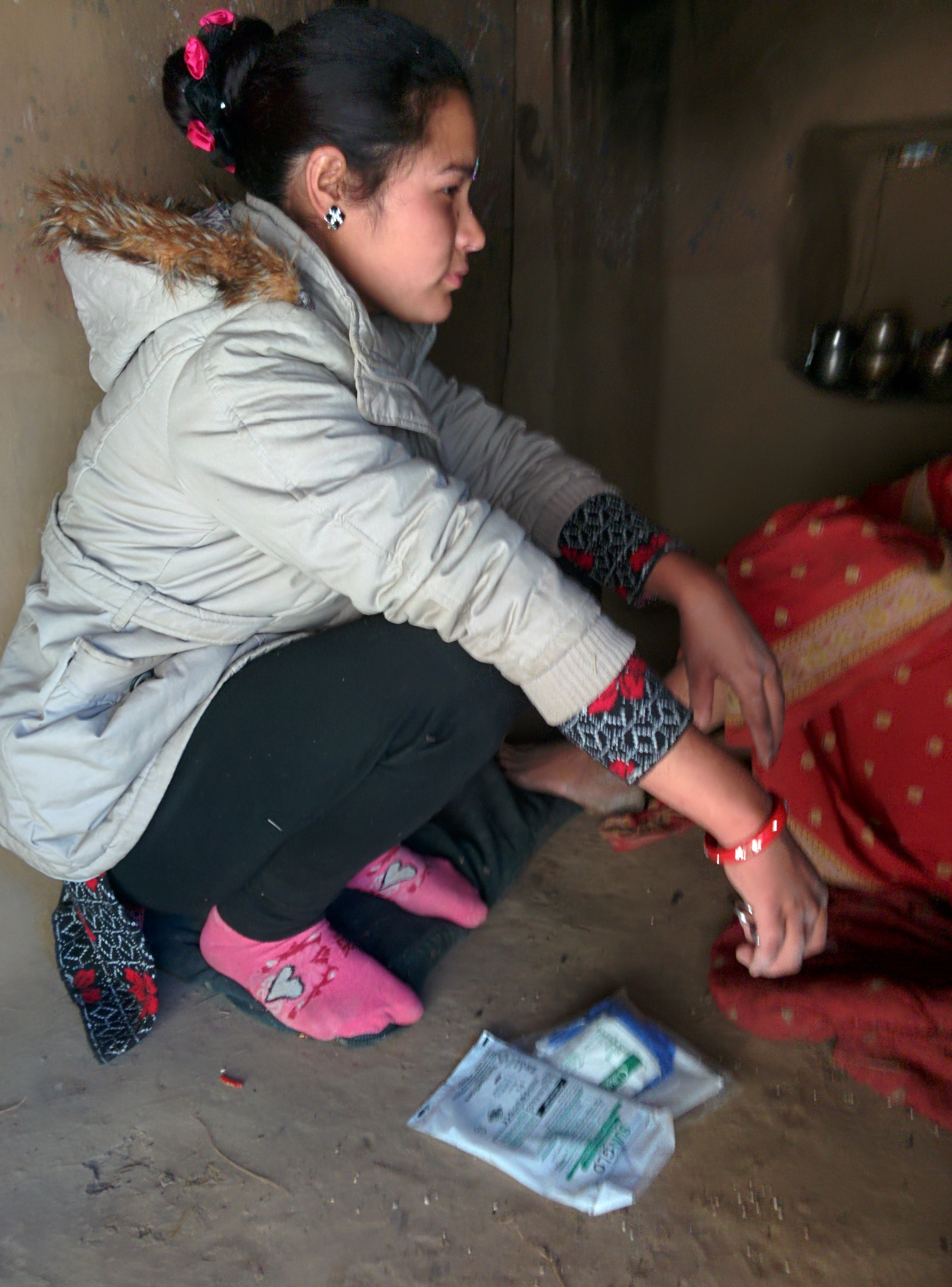 One of community health workers Sarita Singh making a home visit with a hygienic birth kit.