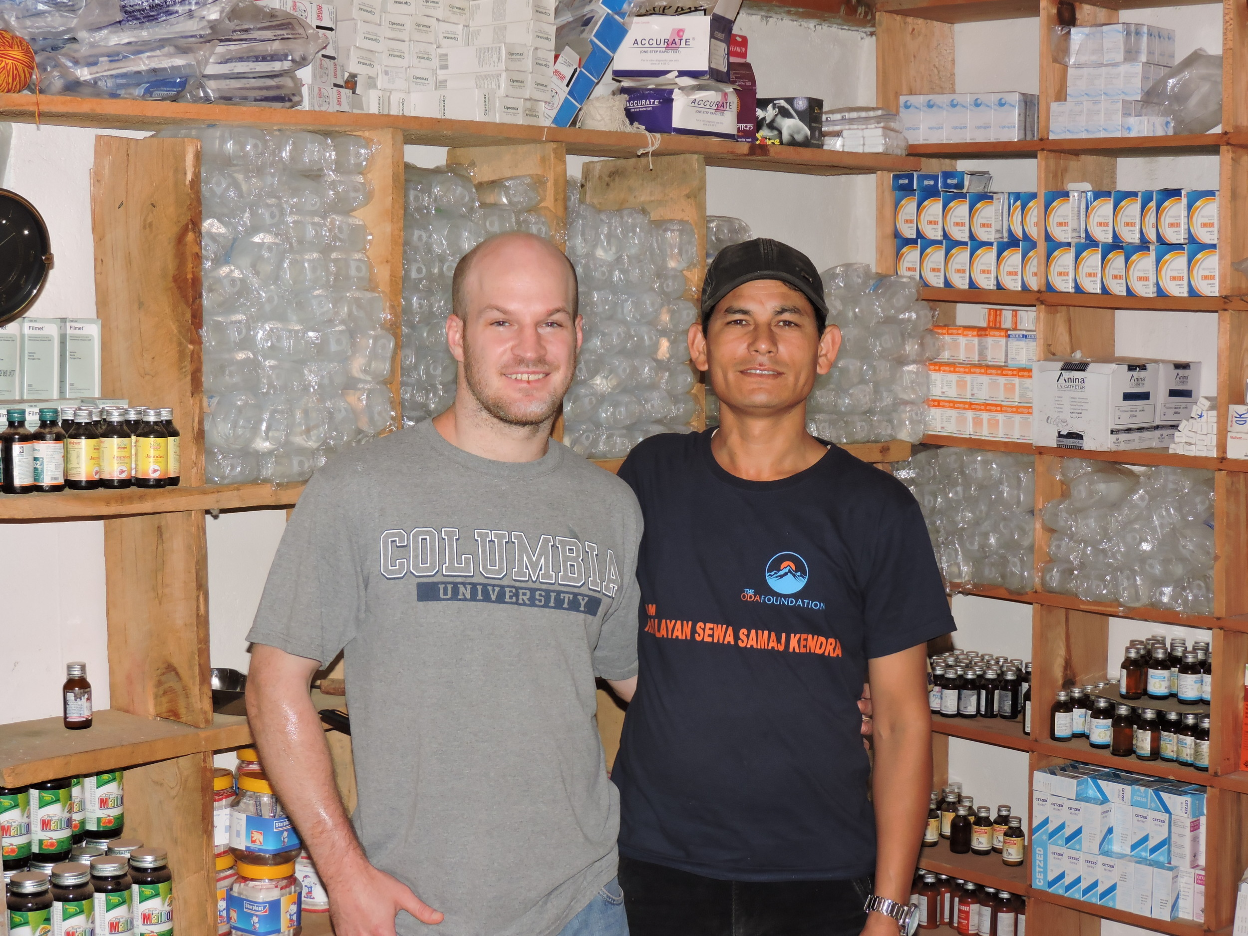 Peter and Dr. Mim in the Pharmacy